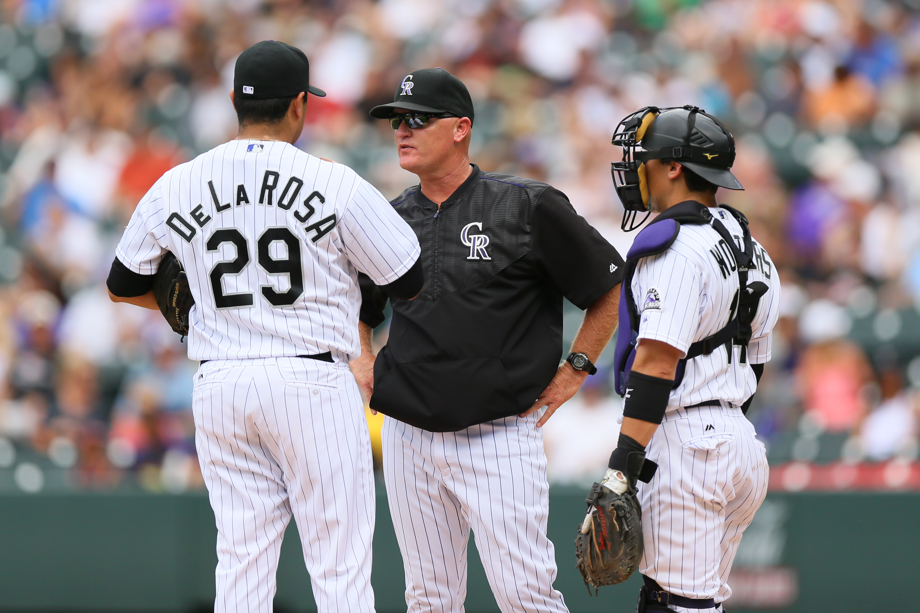 Pitching coach Steve Foster talks to starting pitcher Jorge De La Rosa #29 of the Colorado Rockies as catcher Tony Wolters #14 of the Colorado Rockies listens during the fourth inning against the Tampa Bay Rays at Coors Field on July 20, 2016 in Denver, Colorado. (Photo by Justin Edmonds/Getty Images)
