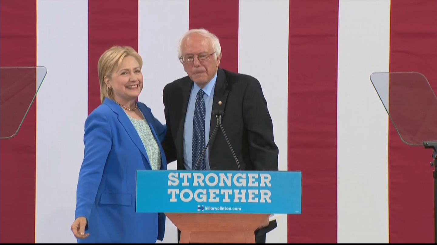 Hillary Clinton and Bernie Sanders at an event on Tuesday (credit: CBS)