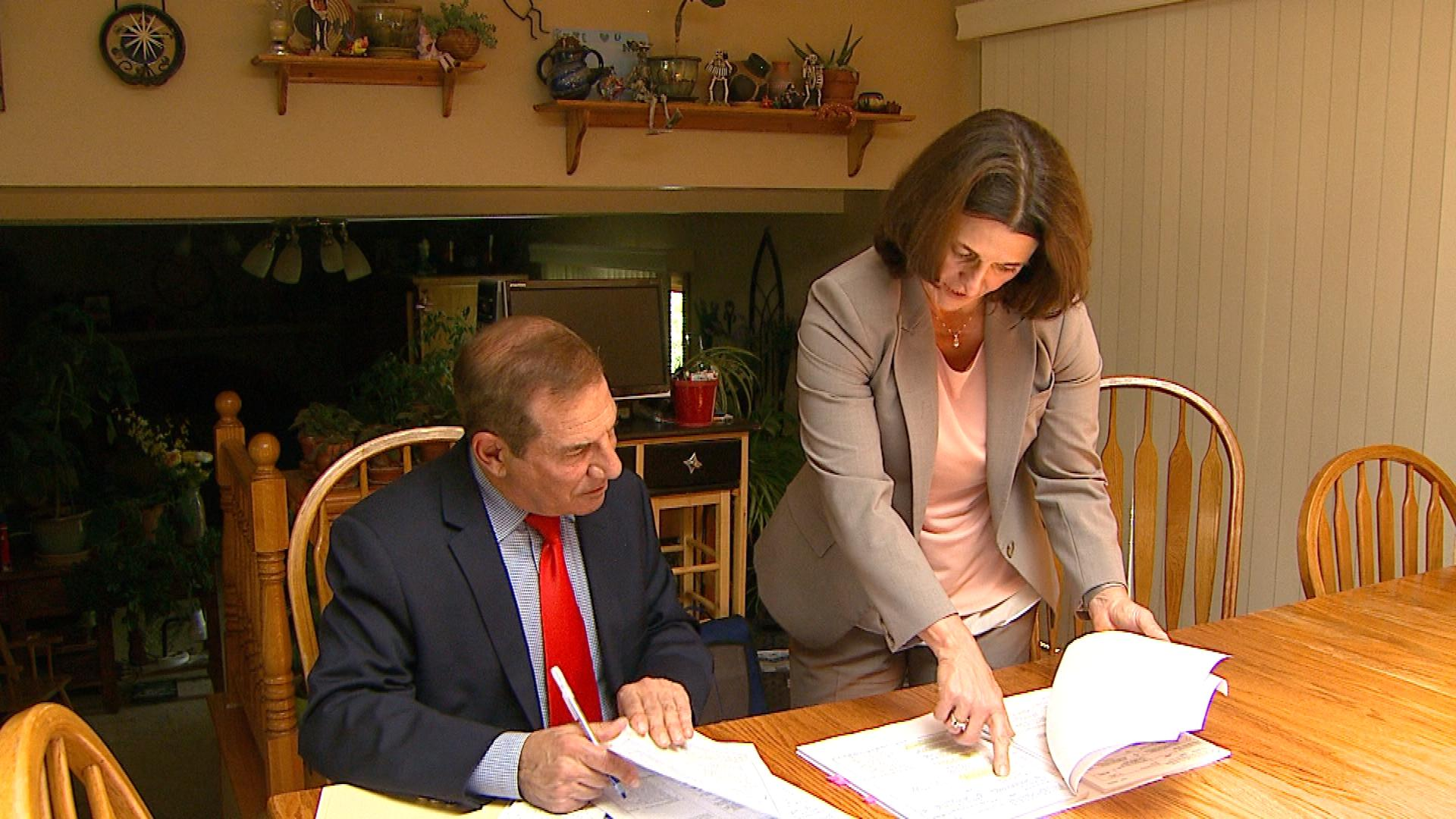 CBS4's Rick Sallinger with Scott Patzer's attorney Hollynd Hoskins (credit: CBS)