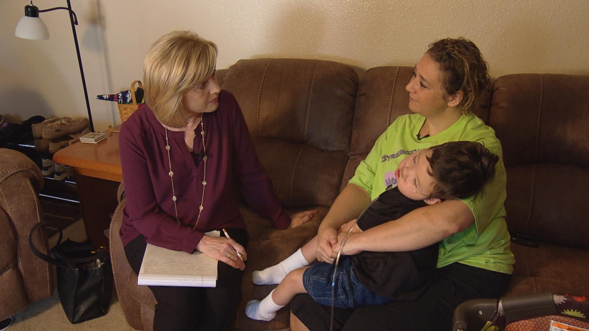 CBS4's Kathy Walsh interviews Tiffany Lawrence with her son Avery Burtscher (credit: CBS)