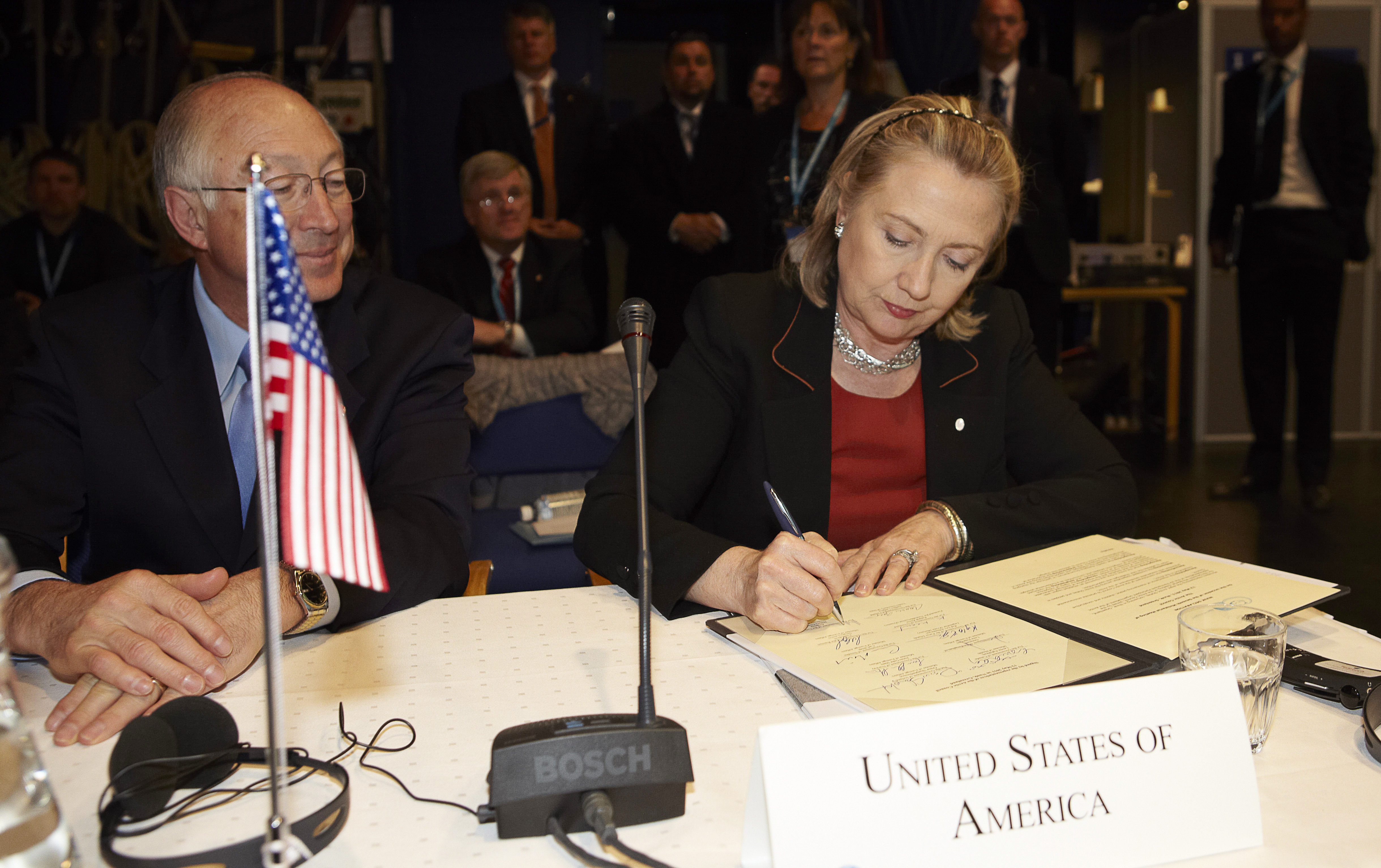 Interior Secretary Ken Salazar looks as Hillary Clinton signs Nuuk Agreement and the Agreement on a common SAR emergency at the meeting of the Arctic Council on May 12, 2011 in Nuuk. (credit: Ulrik Bang/AFP/Getty Images)