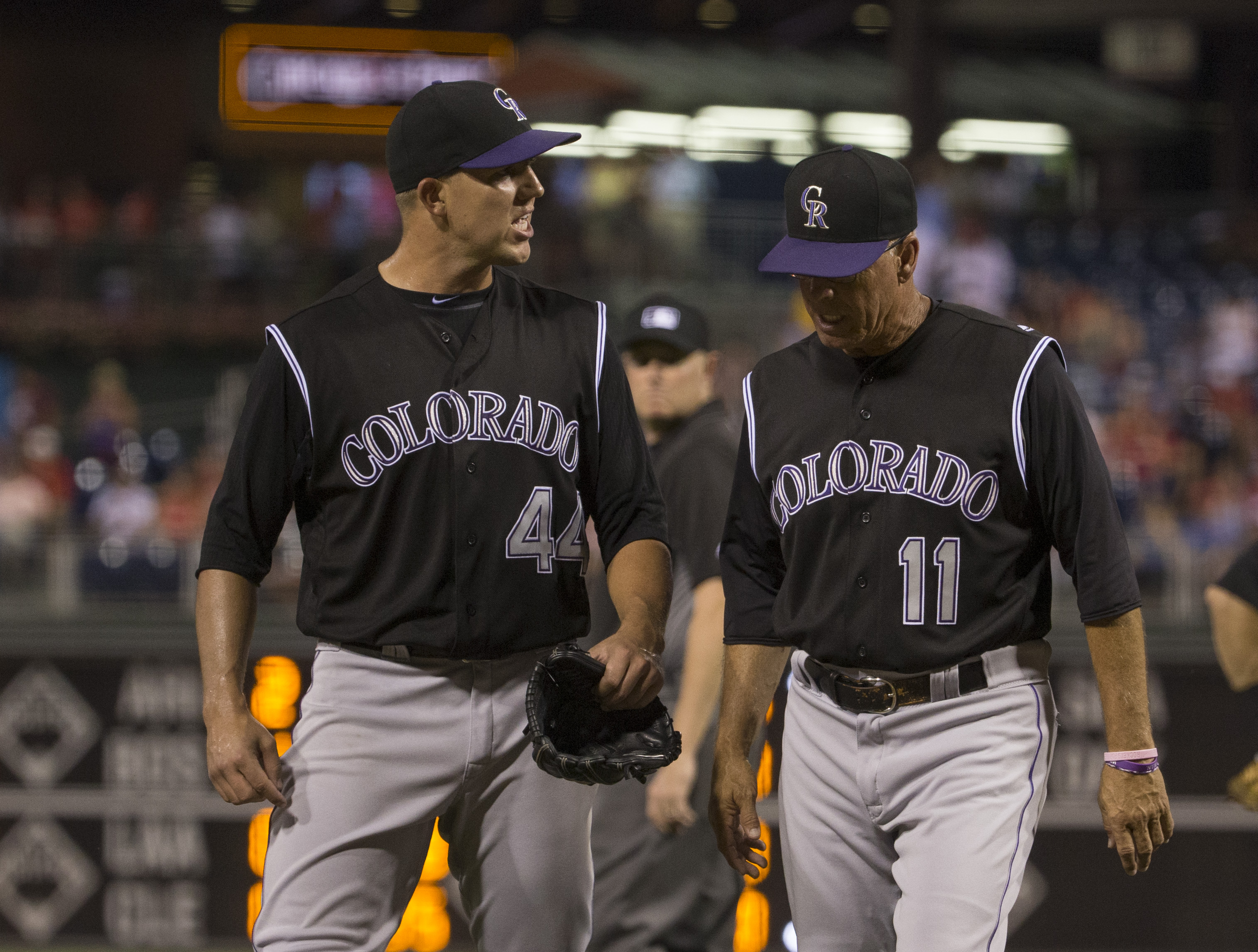 Tyler Anderson #44 of the Colorado Rockies walks off the field with Tom Runnells #11 of the Colorado Rockies after being ejected from the came for hitting Maikel Franco #7 of the Philadelphia Phillies (NOT PICTURED) in the bottom of the fourth inning at Citizens Bank Park on August 13, 2016 in Philadelphia, Pennsylvania. (Photo by Mitchell Leff/Getty Images)