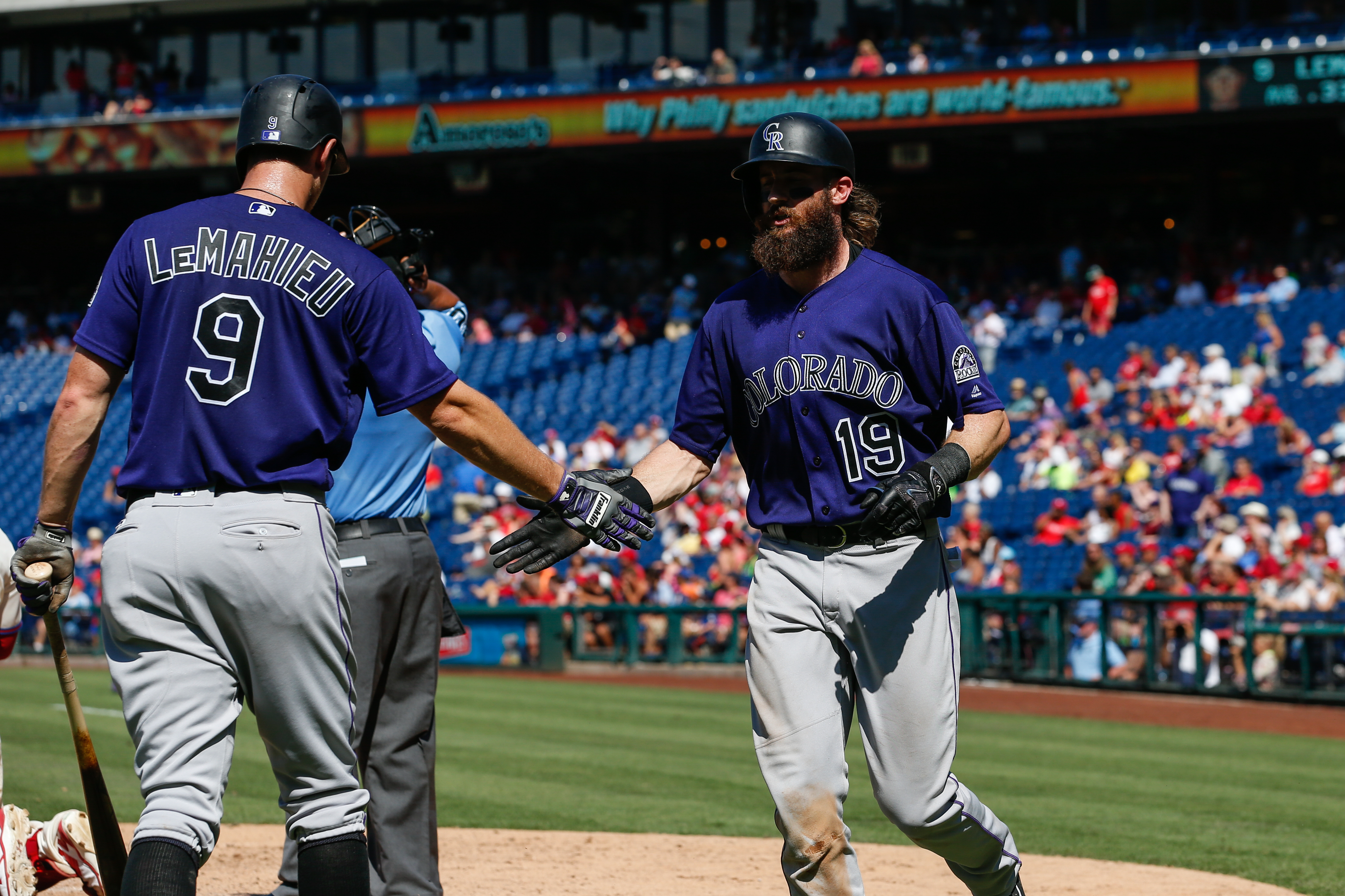 Charlie Blackmon #19 of the Colorado Rockies is congratulated by DJ LeMahieu #9 after Blackmon hit a solo home run in the fifth inning of the game against the Philadelphia Phillies at Citizens Bank Park on August 14, 2016 in Philadelphia, Pennsylvania. The Phillies won 7-6. (Photo by Brian Garfinkel/Getty Images)