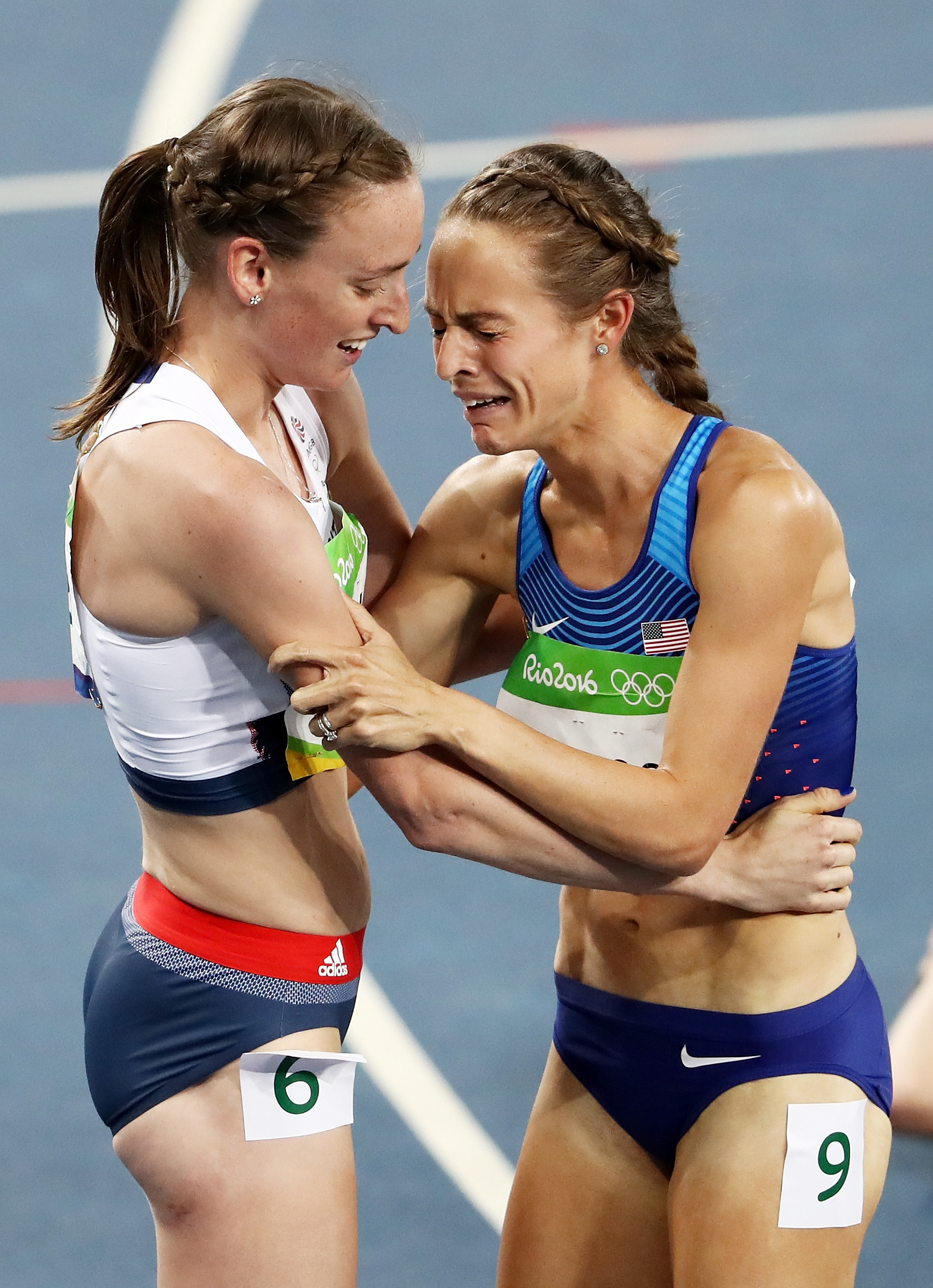 Laura Weightman of Great Britain hugs bronze medalist Jenny Simpson of the United States after the Women's 1500m Final on Day 11 of the Rio 2016 Olympic Games at the Olympic Stadium on August 16, 2016 in Rio de Janeiro, Brazil. (credit: Alexander Hassenstein/Getty Images)