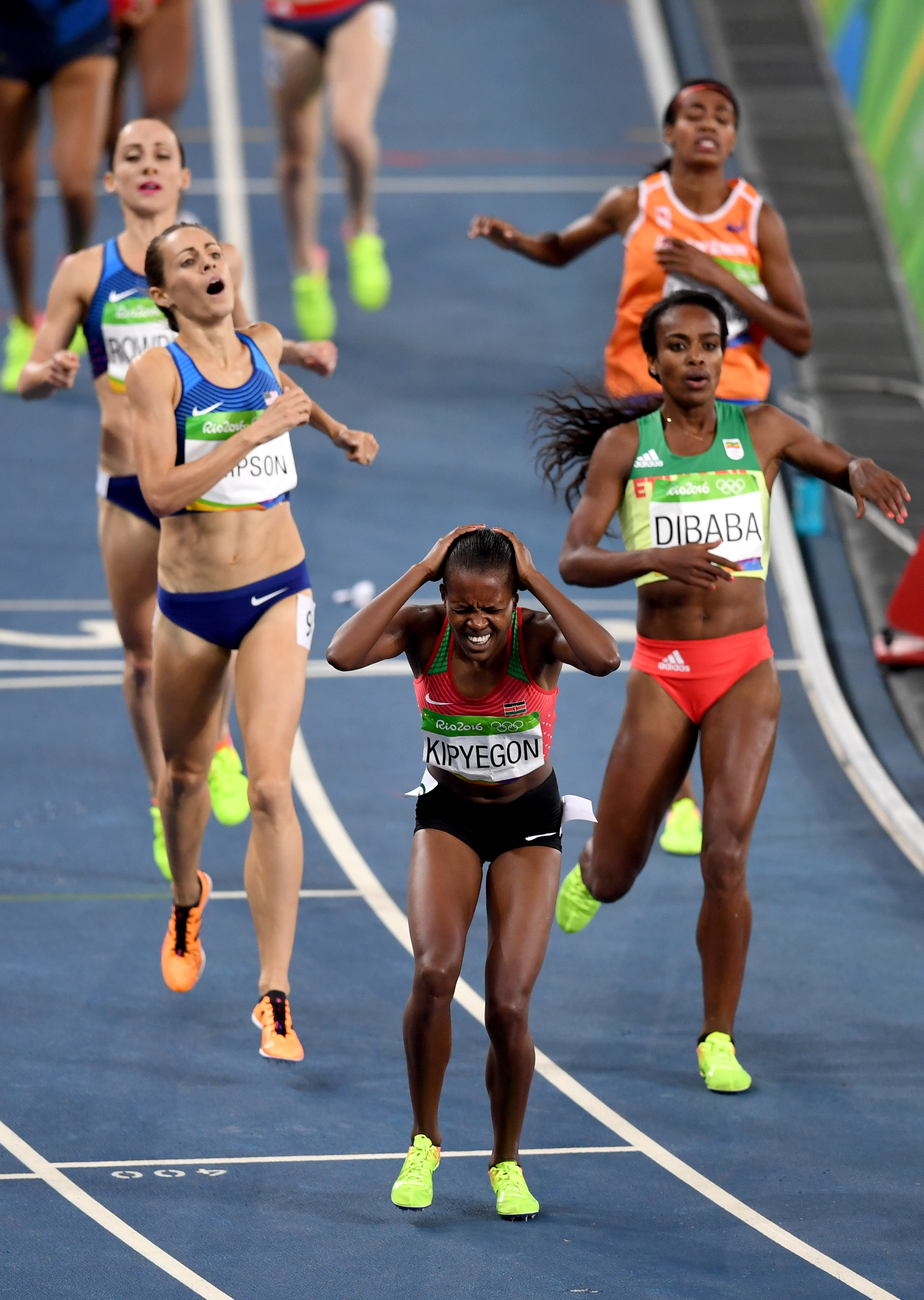 Kenya's Faith Chepngetich Kipyegon (center) reacts after she won ahead of Ethiopia's Genzebe Dibaba (right) and USA's Jenny Simpson the Women's 1500m Final during the athletics event at the Rio 2016 Olympic Games at the Olympic Stadium in Rio de Janeiro on August 16, 2016. (credit: PEDRO UGARTE/AFP/Getty Images)