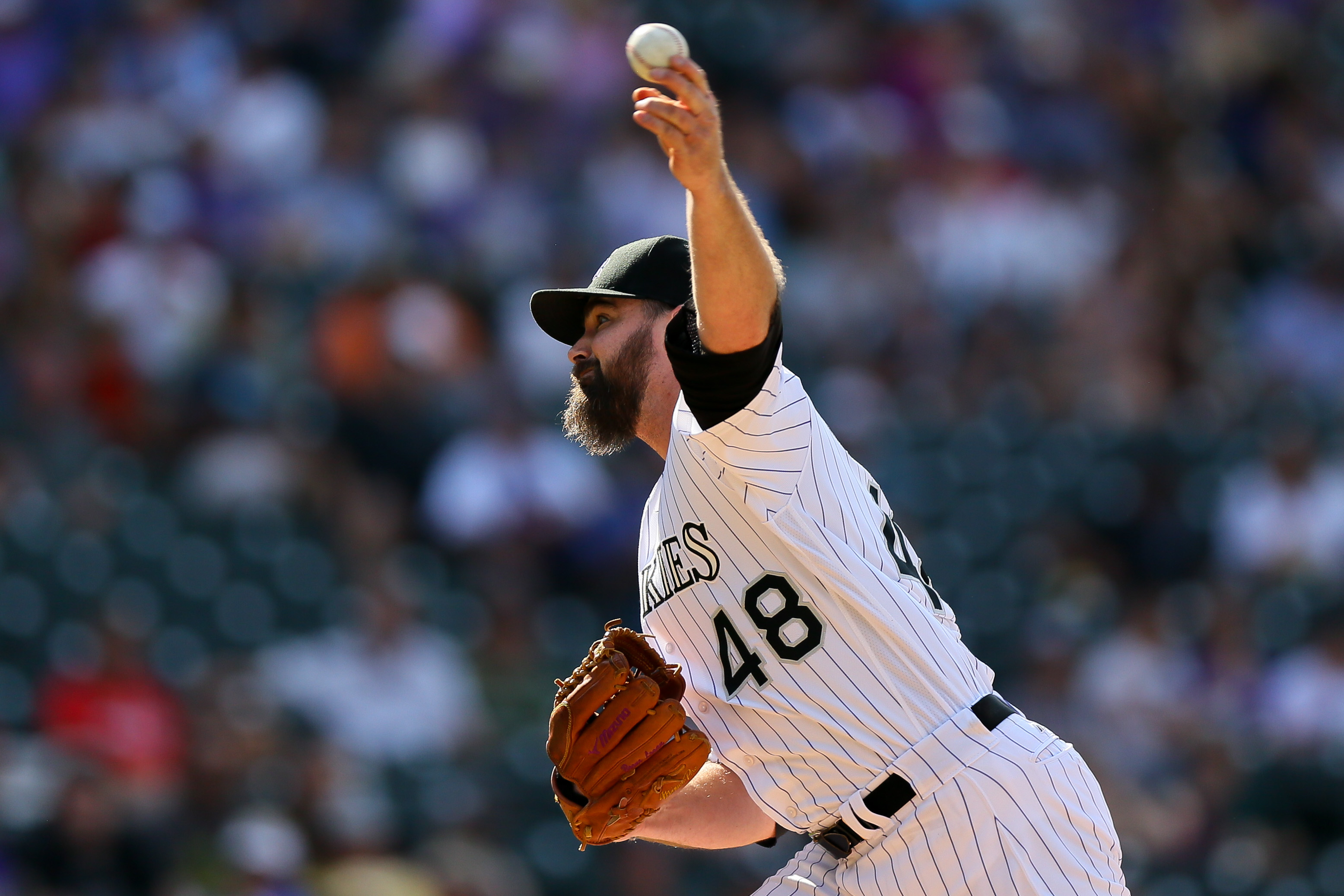 Relief pitcher Boone Logan #48 of the Colorado Rockies delivers to home plate during the eighth inning against the Washington Nationals at Coors Field on August 17, 2016 in Denver, Colorado. (Photo by Justin Edmonds/Getty Images)