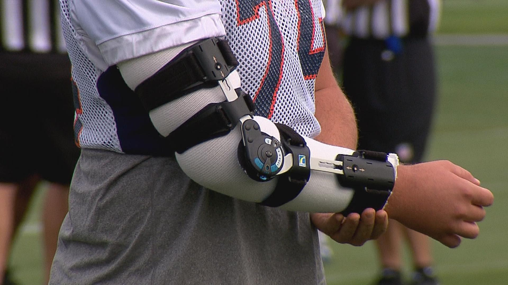 Ty Sambrailo with elbow brace (credit: CBS)