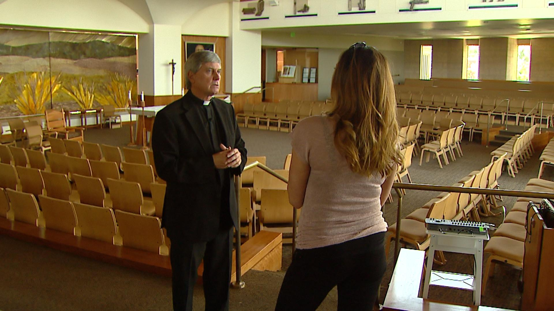 Father Kevin Burke is interviewed by CBS4's Jennifer Brice (credit: CBS)