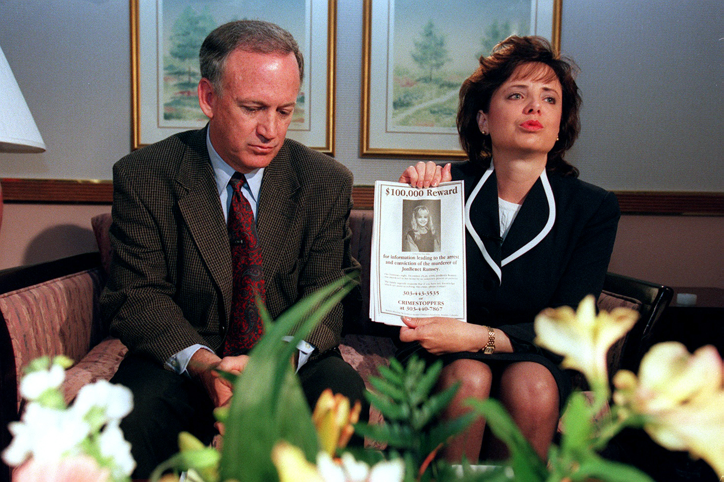 John and Patsy Ramsey, the parents of JonBenet Ramsey, meet reporters after four months of silence in Boulder on May 1, 1997. Patsy holds up a reward sign for information leading to the arrest of their daughter's murderer. Their 6-year-old daughter was found dead on Christmas night 1996. (Photo By Helen H. Richardson/ The Denver Post)
