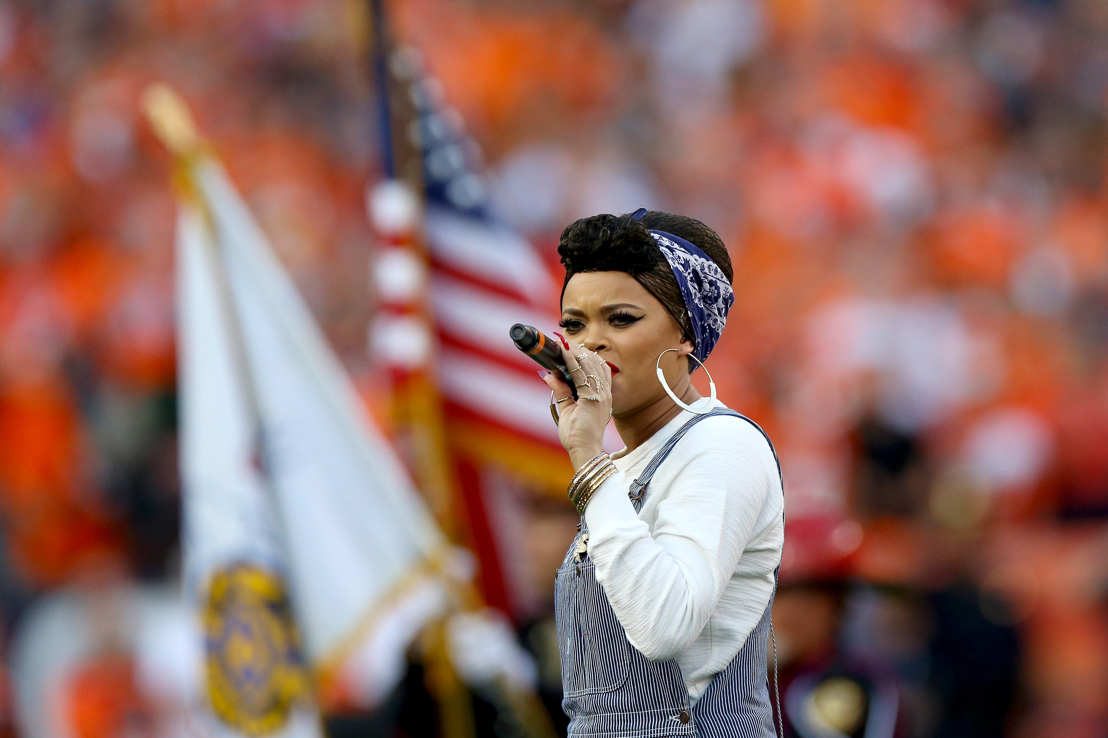 Singer Andra Day performs the National Anthem before the Denver Broncos take on the Carolina Panthers at Sports Authority Field at Mile High on Sept. 8, 2016. (credit: Justin Edmonds/Getty Images)