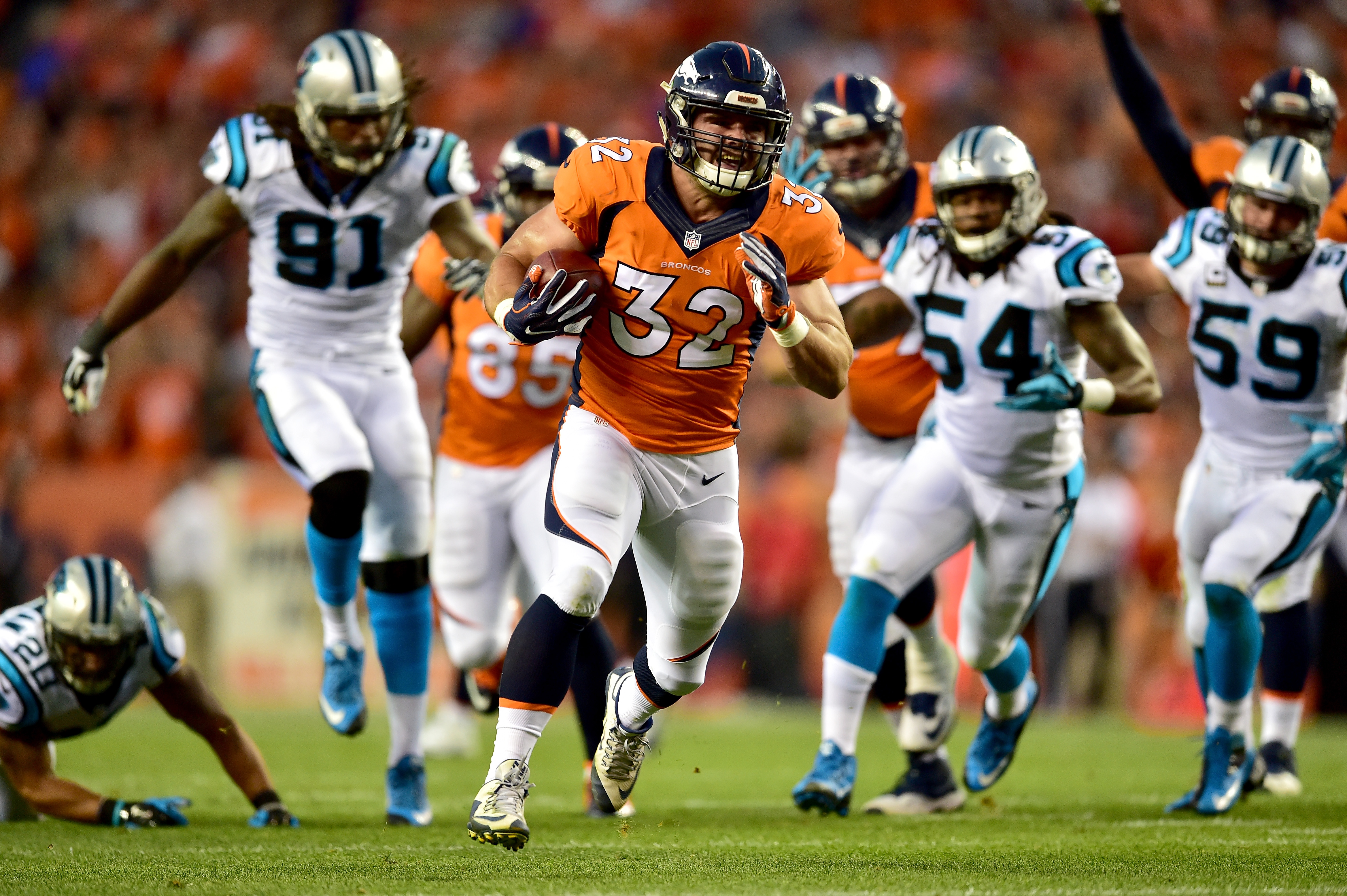 Fullback Andy Janovich of the Denver Broncos scores on a 28-yard touchdown run against the Carolina Panthers in the second quarter at Sports Authority Field at Mile High on September 8, 2016 in Denver, Colorado. (Photo by Dustin Bradford/Getty Images)