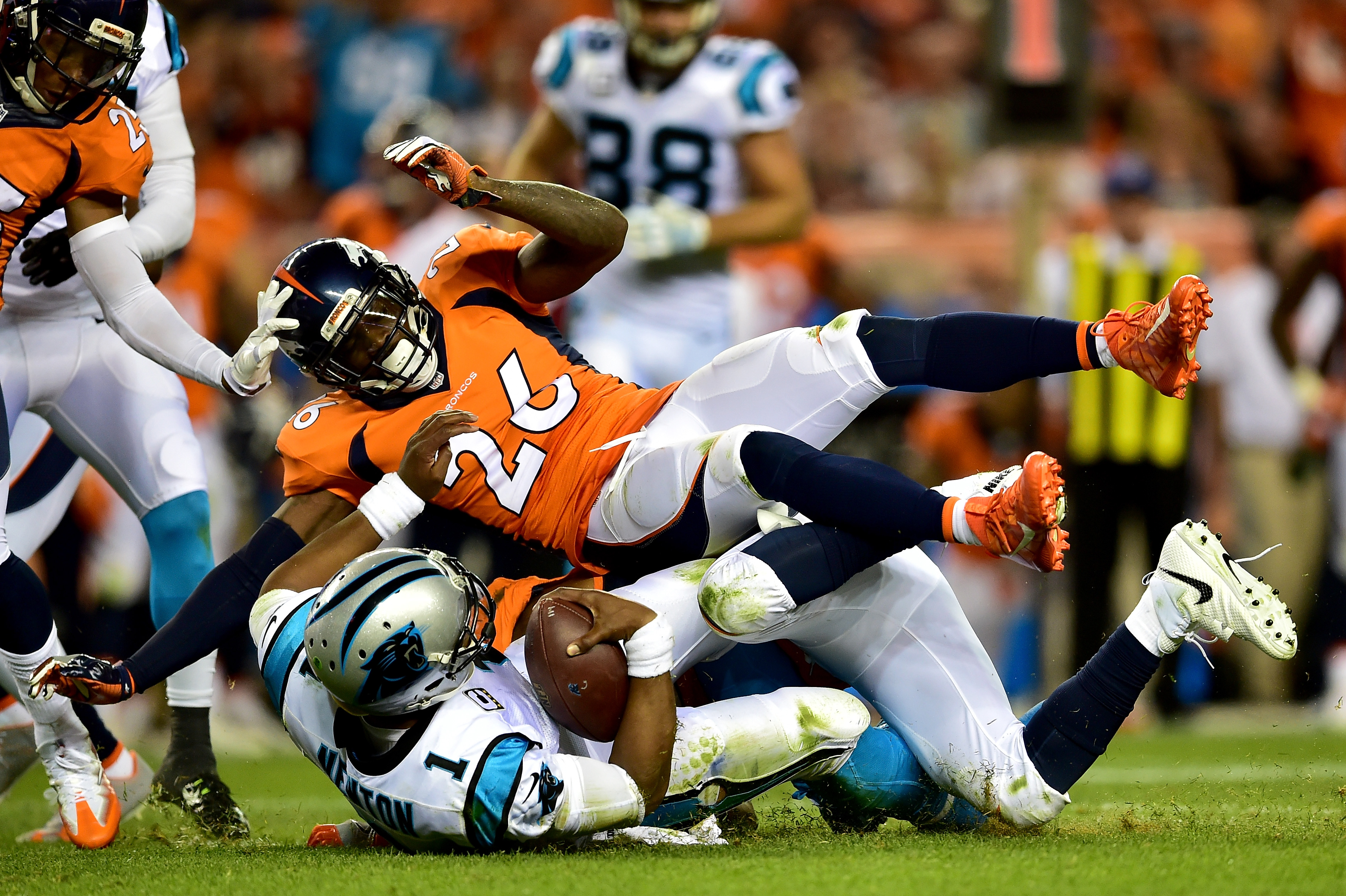 Quarterback Cam Newton #1 of the Carolina Panthers is hit by free safety Darian Stewart #26 of the Denver Broncos in the third quarter at Sports Authority Field at Mile High on September 8, 2016 in Denver, Colorado. (Photo by Dustin Bradford/Getty Images)