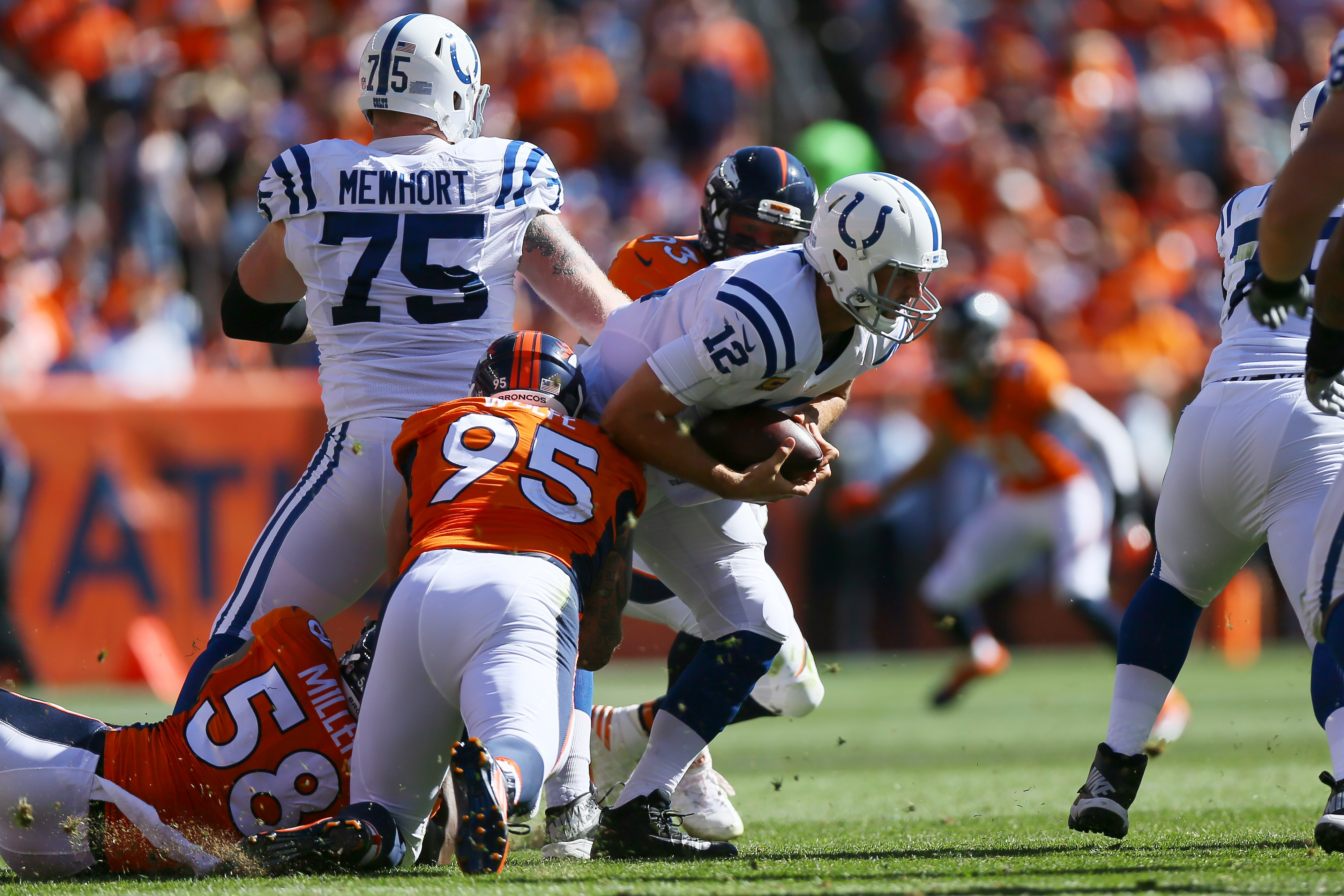Outside linebacker Von Miller #58 and defensive end Derek Wolfe #95 of the Denver Broncos sack quarterback Andrew Luck of the Indianapolis Colts in the second quarter of the game at Sports Authority Field at Mile High on September 18, 2016. (Photo by Justin Edmonds/Getty Images)