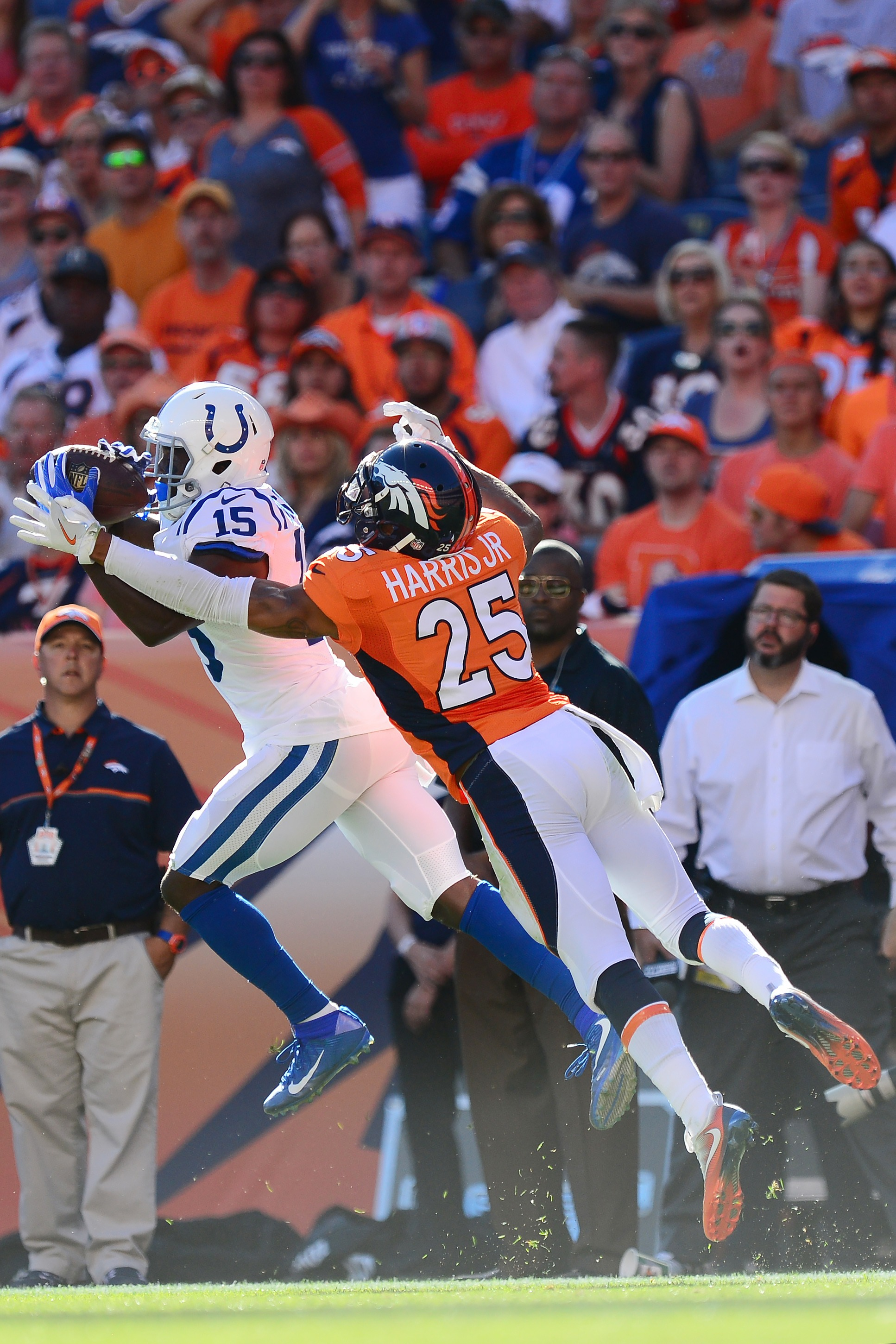 Wide receiver Phillip Dorsett #15 of the Indianapolis Colts catches a 35-yard-completion in the third quarter of the game while defended by cornerback Chris Harris #25 of the Denver Broncos at Sports Authority Field at Mile High on September 18, 2016 in Denver, Colorado. (Photo by Dustin Bradford/Getty Images)