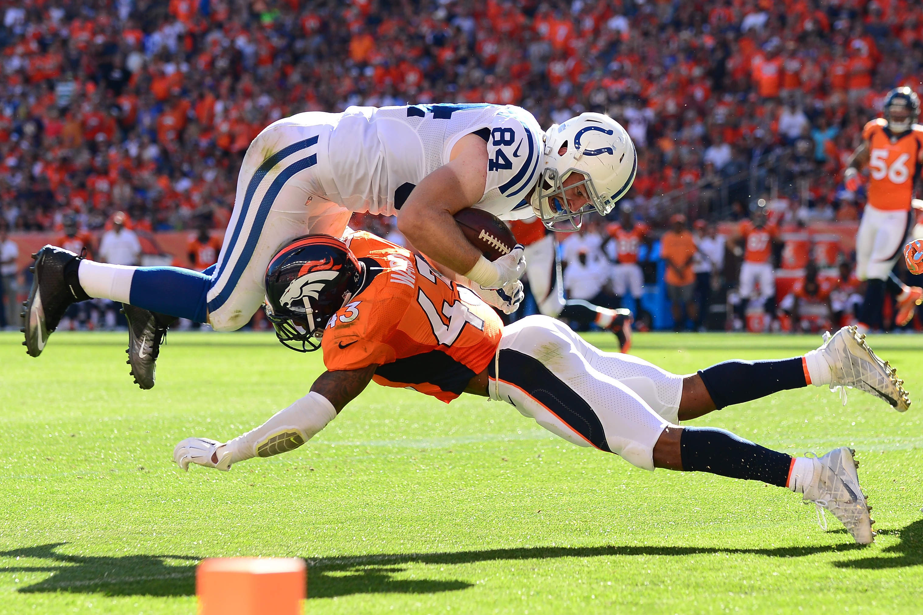 Strong safety T.J. Ward #43 of the Denver Broncos tackles tight end Jack Doyle #84 of the Indianapolis Colts in the red zone in the third quarter of the game at Sports Authority Field at Mile High on September 18, 2016 in Denver, Colorado. (Photo by Dustin Bradford/Getty Images)
