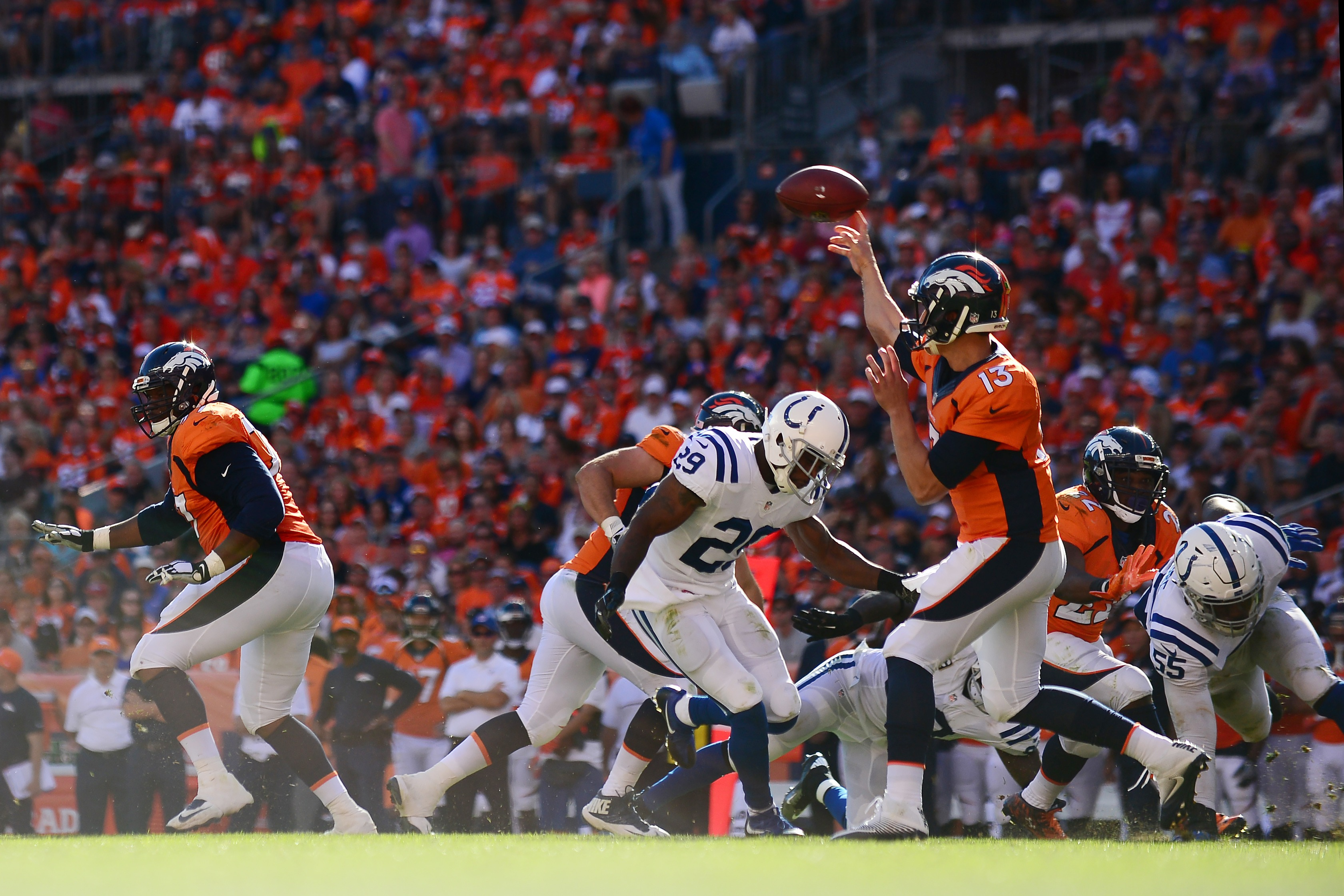 Quarterback Trevor Siemian of the Denver Broncos throws for a completion in the third quarter of the game against the Indianapolis Colts on Sept. 18, 2016 in Denver. (credit: Dustin Bradford/Getty Images)