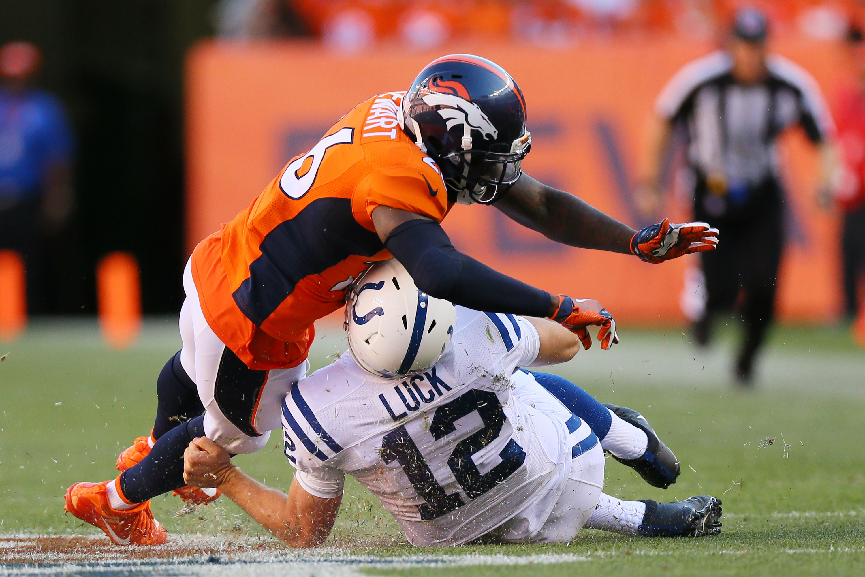 DENVER, CO - SEPTEMBER 18: Free safety Darian Stewart #26 of the Denver Broncos is called for unnecessary roughness for tackling quarterback Andrew Luck #12 of the Indianapolis Colts as he slides for a first down in the fourth quarter of the game at Sports Authority Field at Mile High on September 18, 2016 in Denver, Colorado. (Photo by Justin Edmonds/Getty Images)