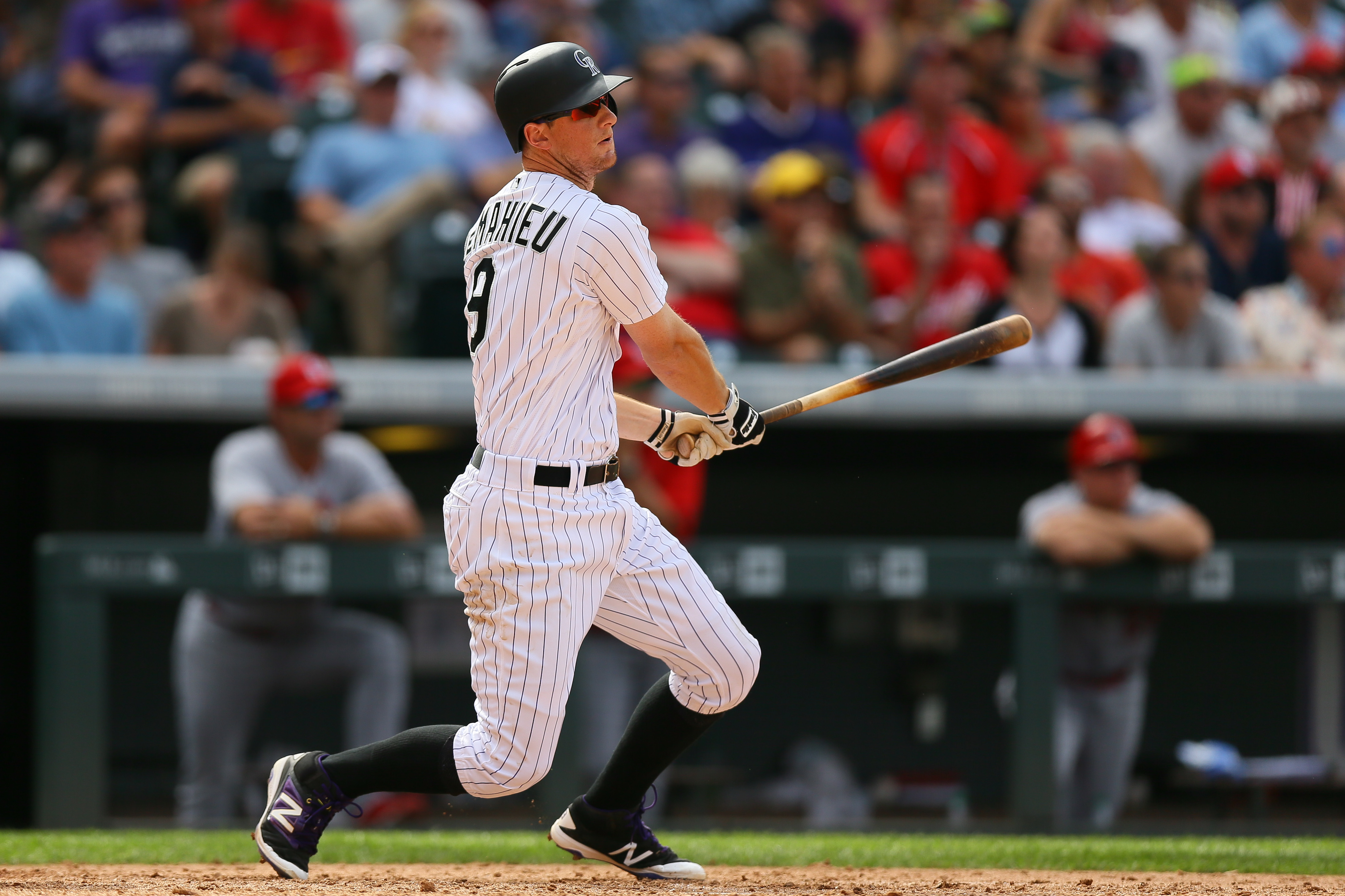 DENVER, CO - SEPTEMBER 21: DJ LeMahieu #9 of the Colorado Rockies watches his RBI double during the seventh inning against the St. Louis Cardinals at Coors Field on September 21, 2016 in Denver, Colorado. (Photo by Justin Edmonds/Getty Images)