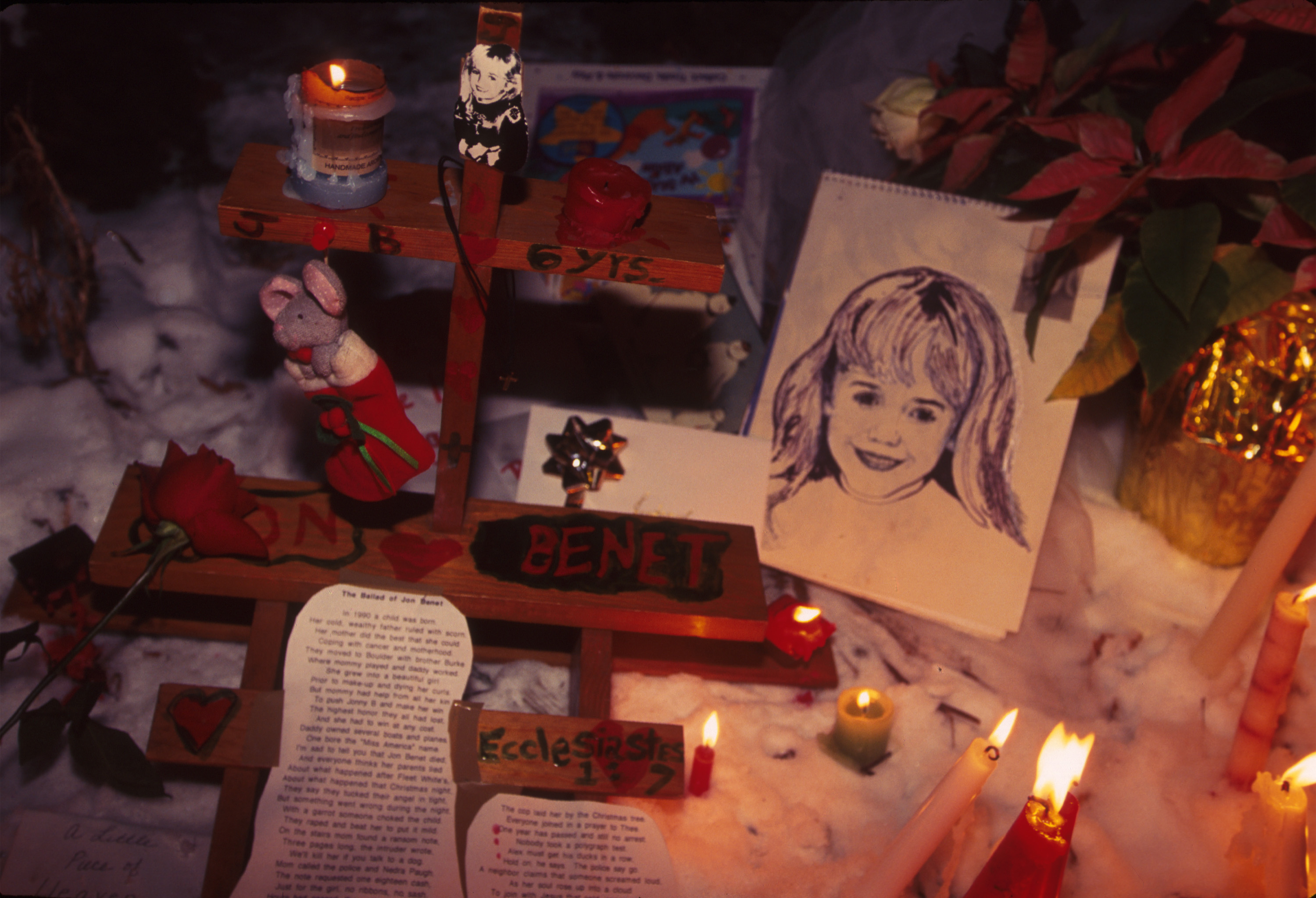 People light candles at the murder site of JonBenet Ramsey in Boulder in December 1997. (credit: Karl Gehring/Liaison)