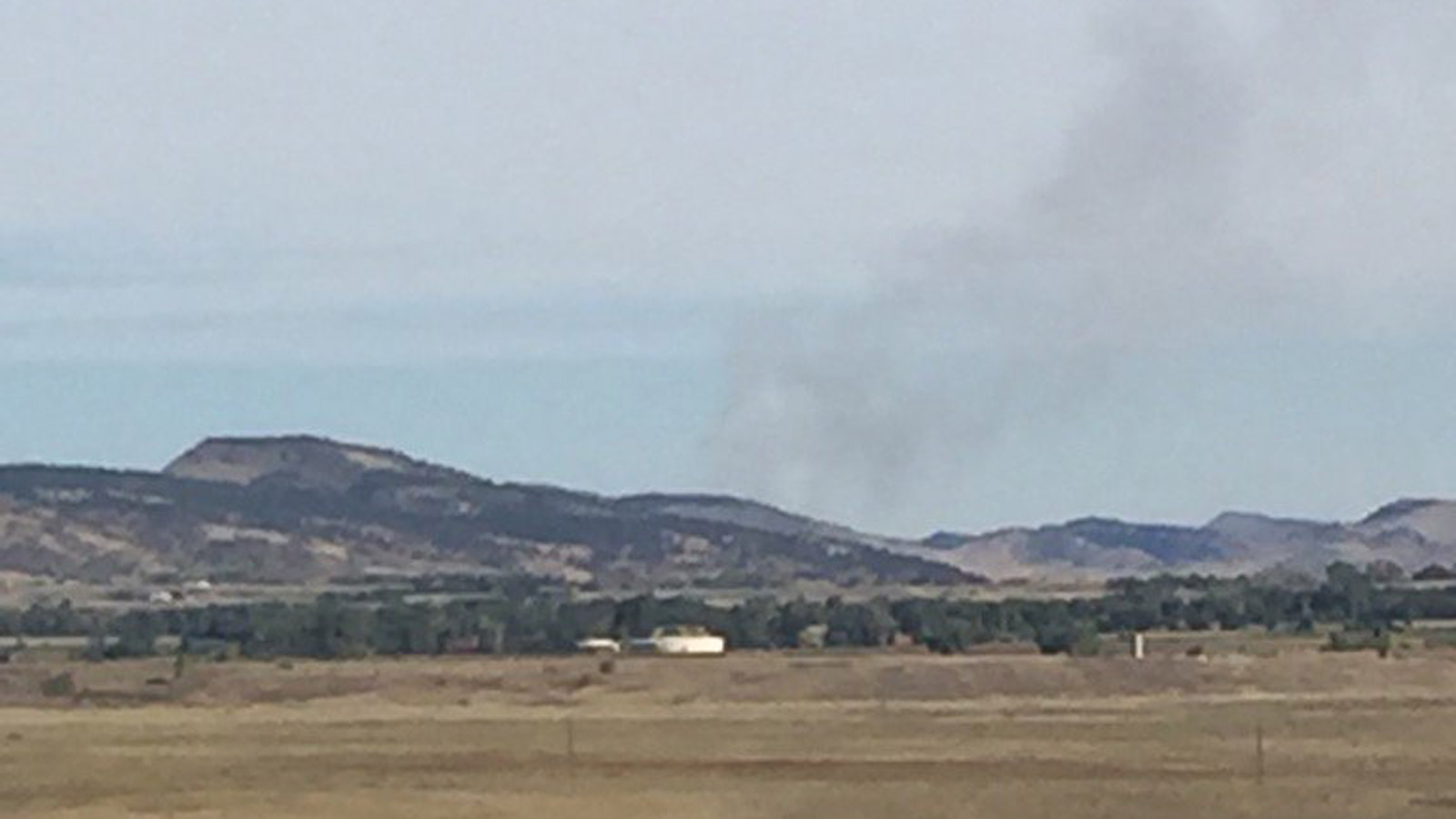 The grass fire burning north of Lyons on Monday morning (credit: Boulder County)