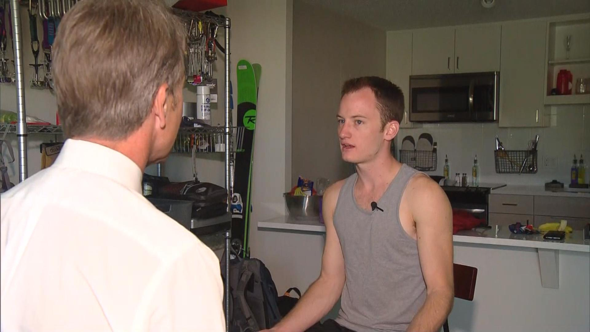 CBS4's Tom Mustin interviews tenant James Cranston (credit: CBS)