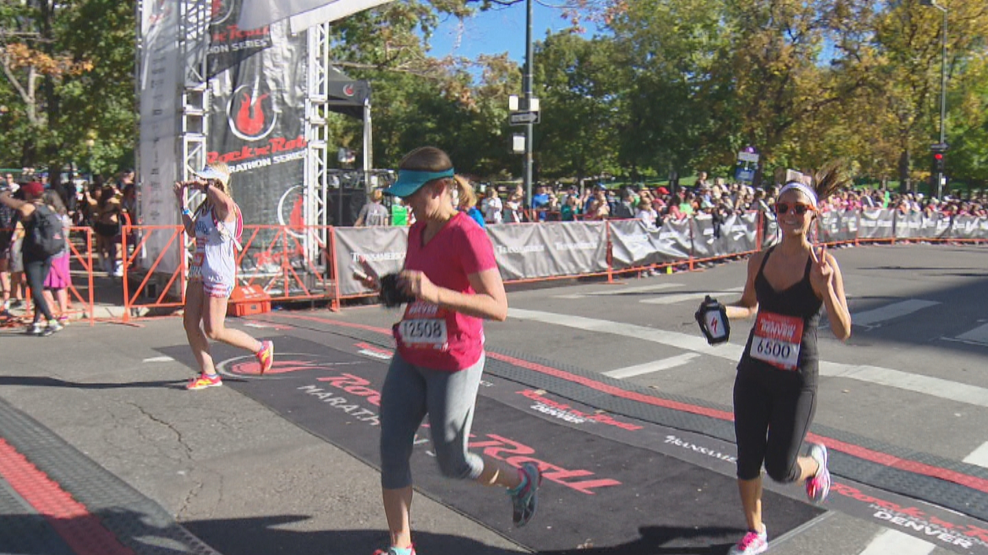 CBS4's Britt Moreno crossing the finish line at the half marathon (credit: CBS)