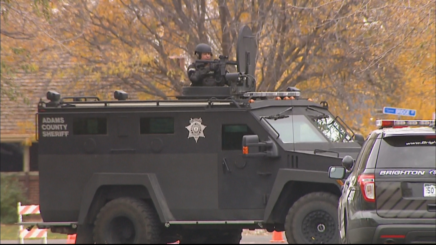 SWAT teams surrounded a home in Brighton (credit: CBS)