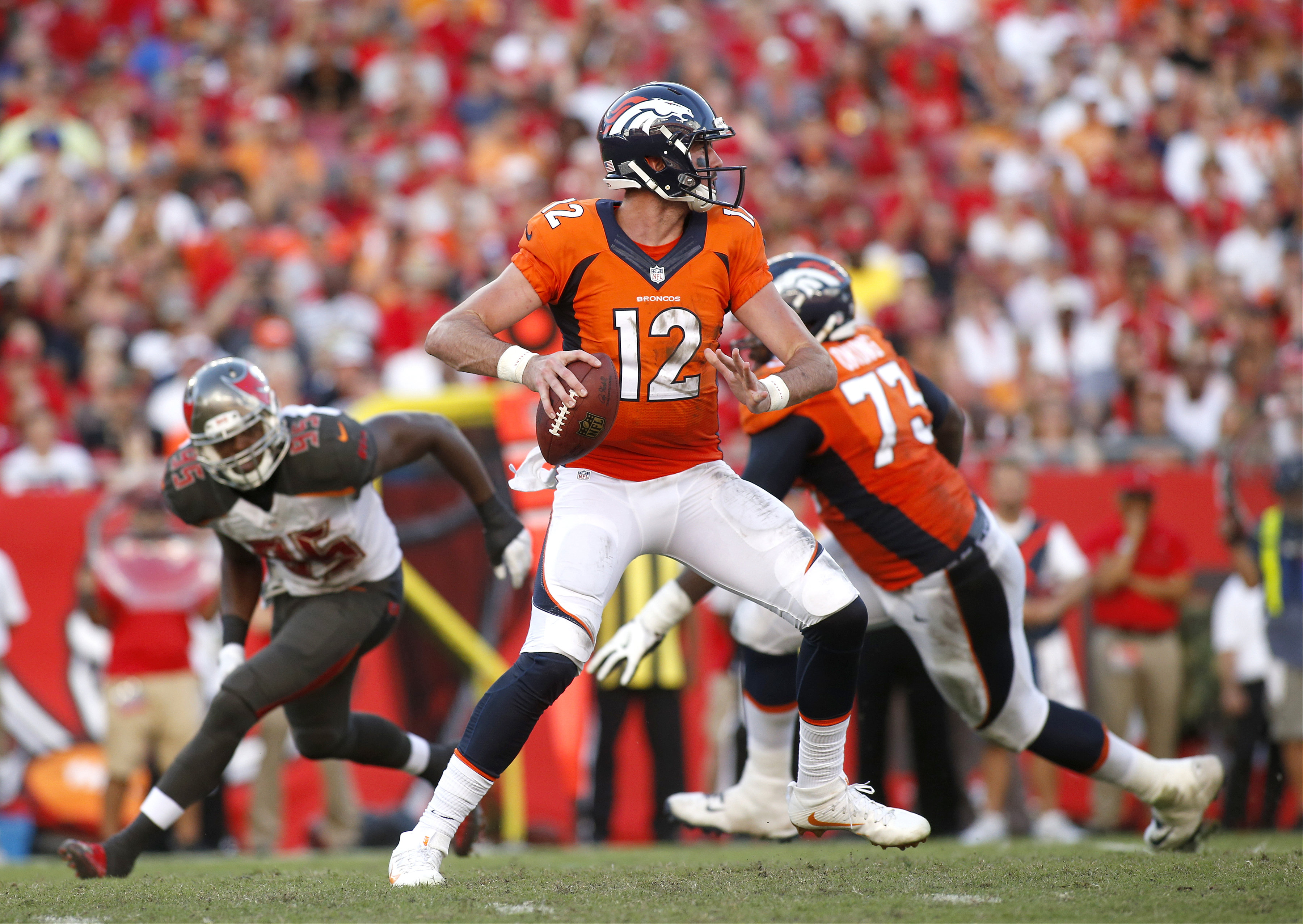 Quarterback Paxton Lynch #12 of the Denver Broncos looks for an open receiver during the third quarter of an NFL game against the Tampa Bay Buccaneers on October 2, 2016 at Raymond James Stadium in Tampa, Florida. (Photo by Brian Blanco/Getty Images)