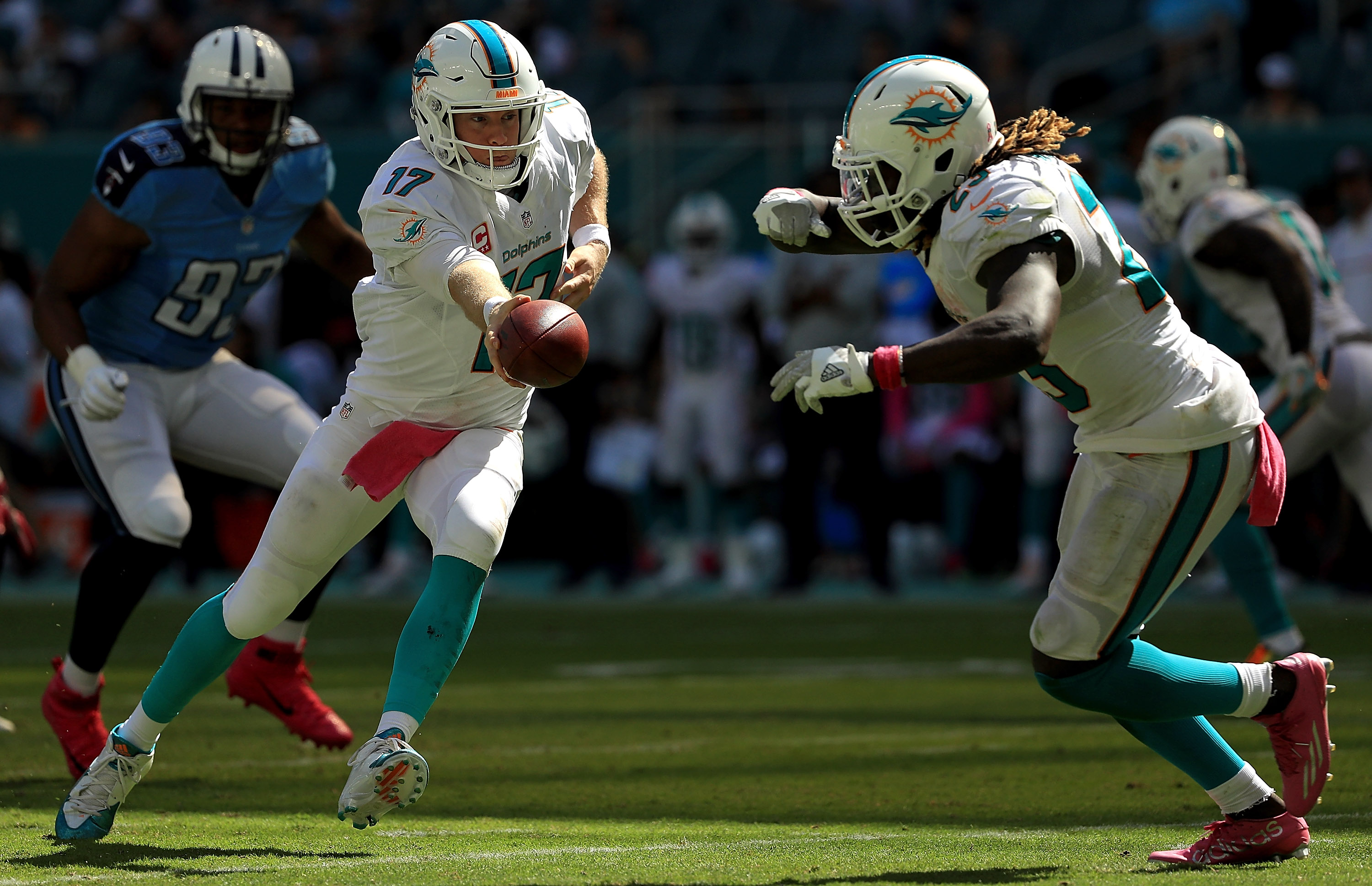 Ryan Tannehill #17 of the Miami Dolphins hands off to Jay Ajayi #23 during a game against the Tennessee Titans on Oct. 9, 2016 in Miami Gardens, Florida. (Photo by Mike Ehrmann/Getty Images)