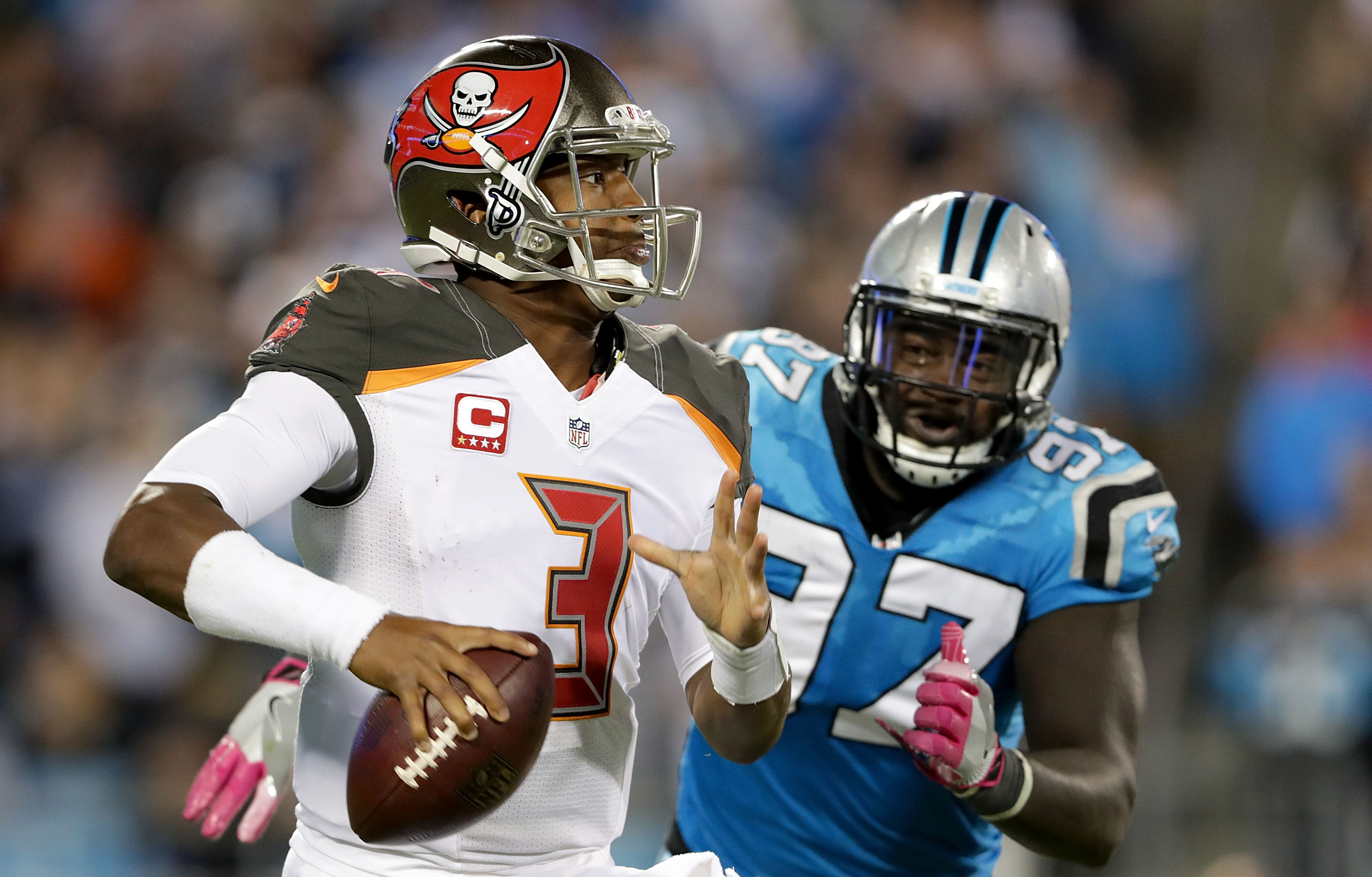 Mario Addison #97 of the Carolina Panthers pursues Jameis Winston #3 of the Tampa Bay Buccaneers in the 2nd half during their game at Bank of America Stadium on October 10, 2016 in Charlotte, North Carolina. (Photo by Streeter Lecka/Getty Images)