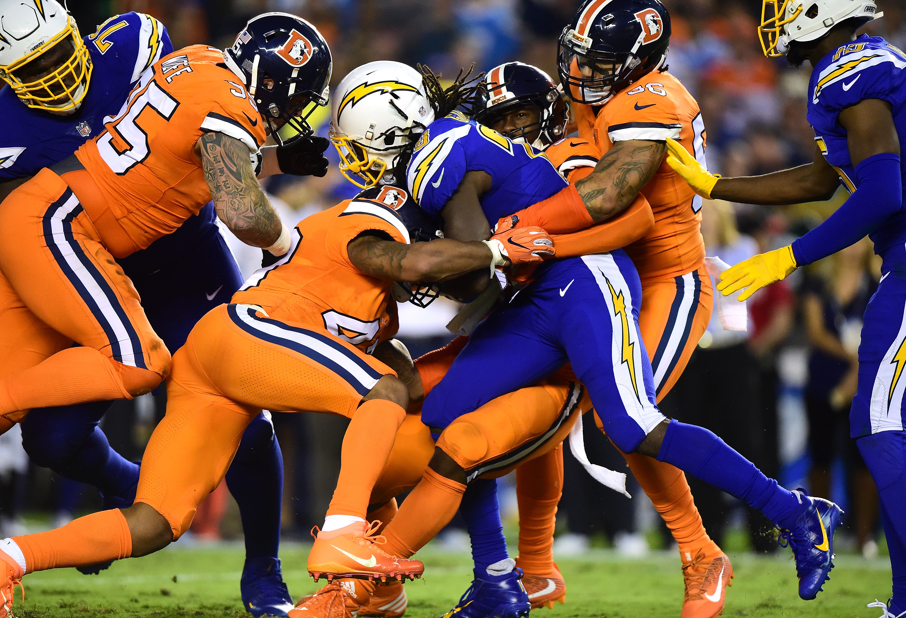 Von Miller #58 of the Denver Broncos tackles Melvin Gordon #28 of the San Diego Chargers during the second quarter at Qualcomm Stadium on Oct. 13, 2016 in San Diego, California. (Photo by Harry How/Getty Images)