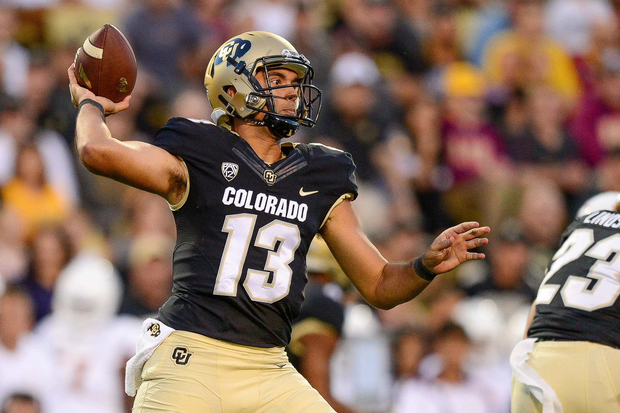 BOULDER, CO - OCTOBER 15: Colorado Buffaloes quarterback Sefo Liufau #13 passes in the first half of a game against the Arizona State Sun Devils at Folsom Field on October 15, 2016 in Boulder, Colorado. (Photo by Dustin Bradford/Getty Images)