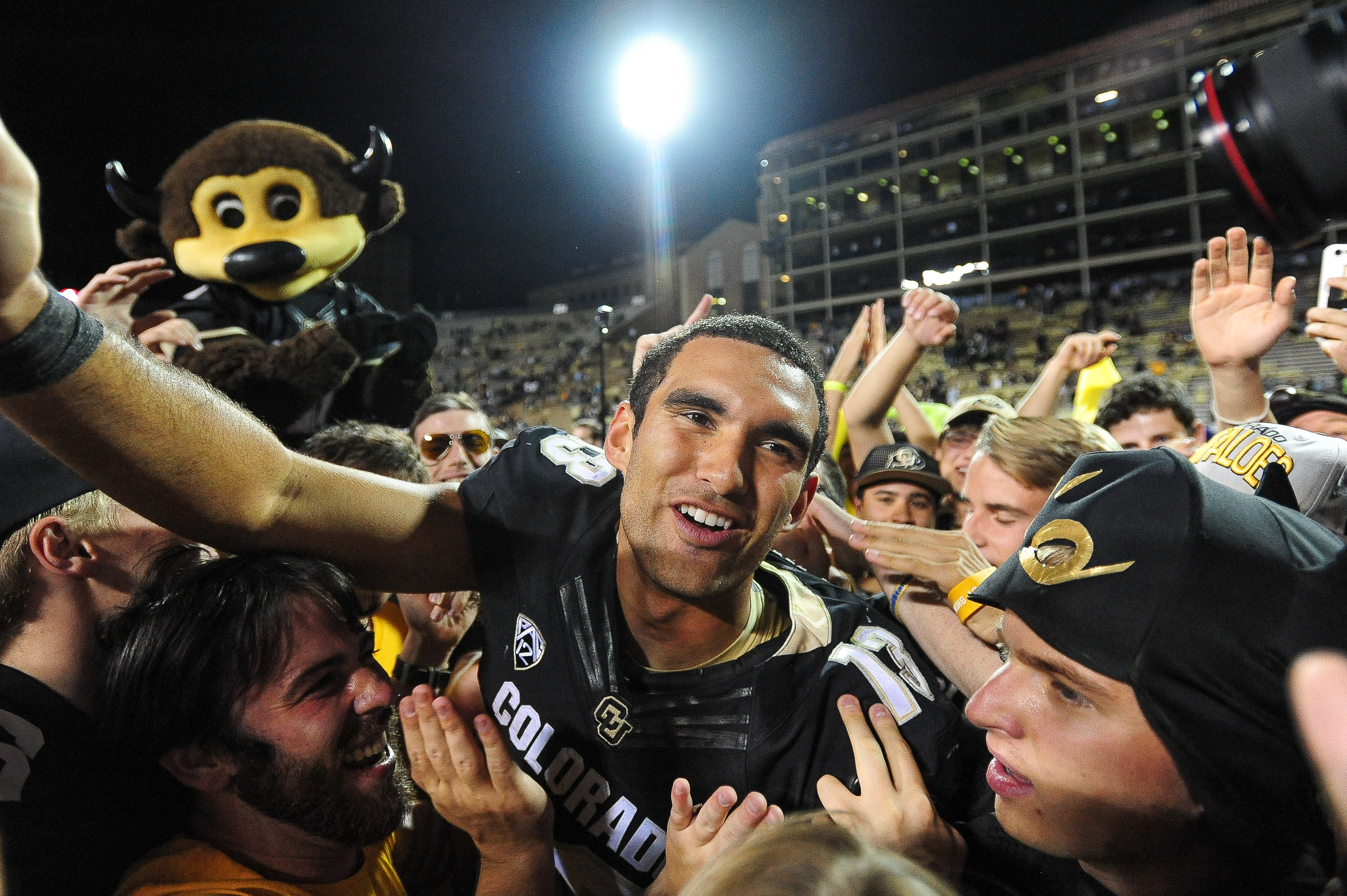 BOULDER, CO - OCTOBER 15: Colorado Buffaloes quarterback Sefo Liufau #13 celebrates with fans who had rushed the field after a 40-16 win over the Arizona State Sun Devils at Folsom Field on October 15, 2016 in Boulder, Colorado. (Photo by Dustin Bradford/Getty Images)