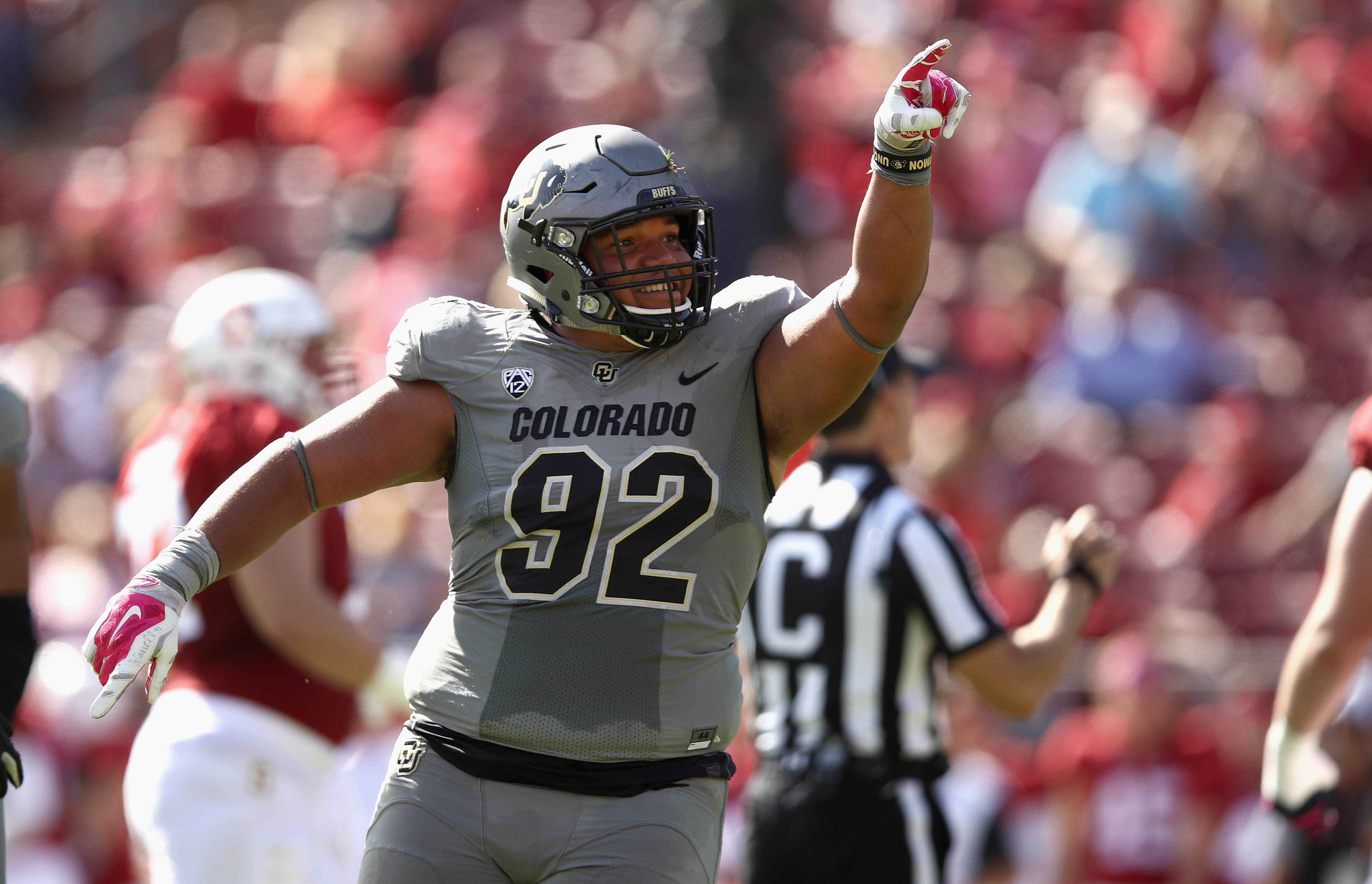 PALO ALTO, CA - OCTOBER 22:  Jordan Carrell #92 of the Colorado Buffaloes reacts after he sacked Ryan Burns #17 of the Stanford Cardinal at Stanford Stadium on October 22, 2016 in Palo Alto, California.  (Photo by Ezra Shaw/Getty Images)