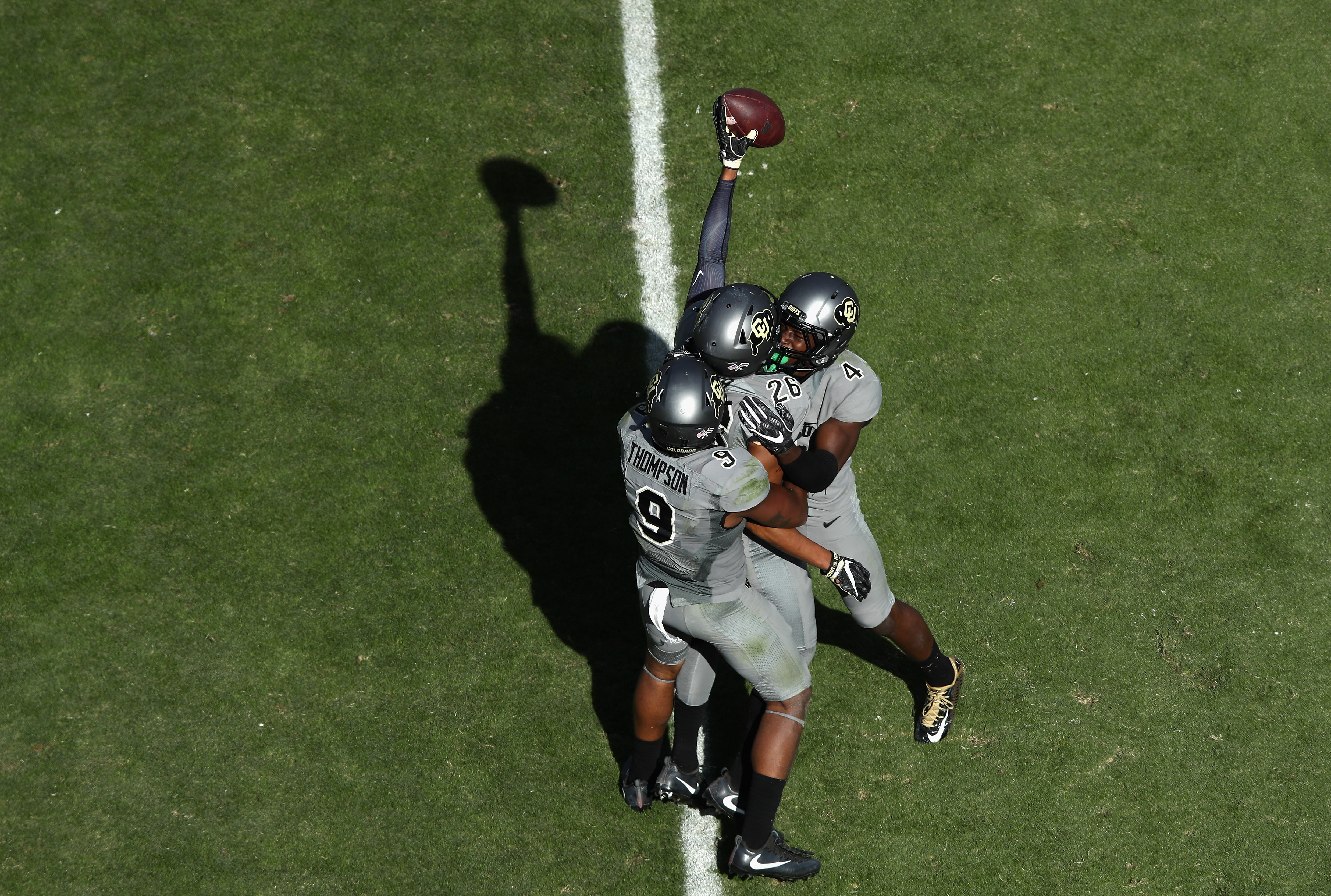 PALO ALTO, CA - OCTOBER 22:  Isaiah Oliver #26 of the Colorado Buffaloes is congratulated by Tedric Thompson #9 and Chidobe Awuzie #4 after he intercepted a pass late in the fourth quarter to secure the Buffaloes victory over the Stanford Cardinal at Stanford Stadium on October 22, 2016 in Palo Alto, California.  (Photo by Ezra Shaw/Getty Images)