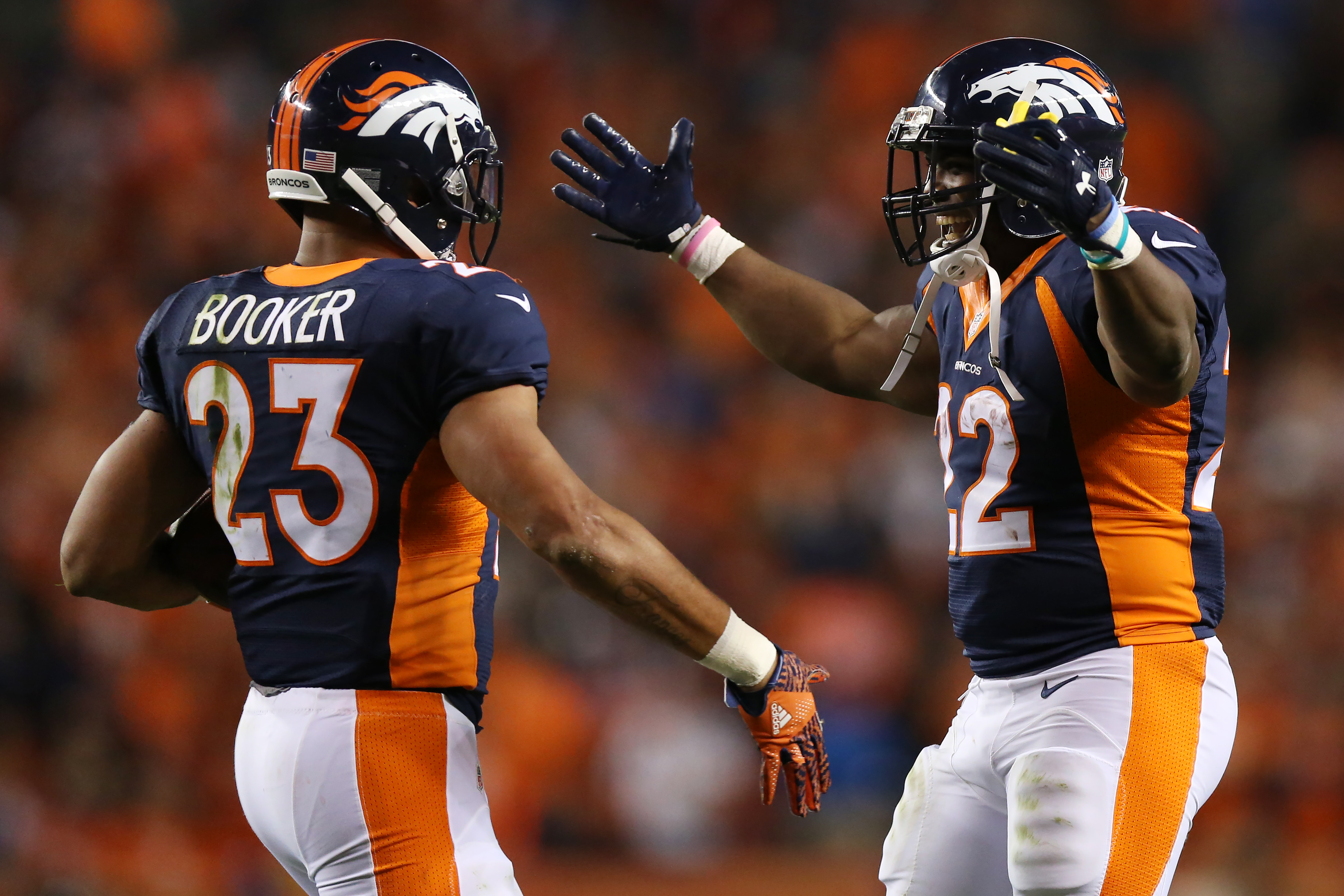 Running back Devontae Booker #23 and running back C.J. Anderson #22 of the Denver Broncos celebrate a score in the second half of the game against the Houston Texans on October 24, 2016 in Denver. (Photo by Justin Edmonds/Getty Images)