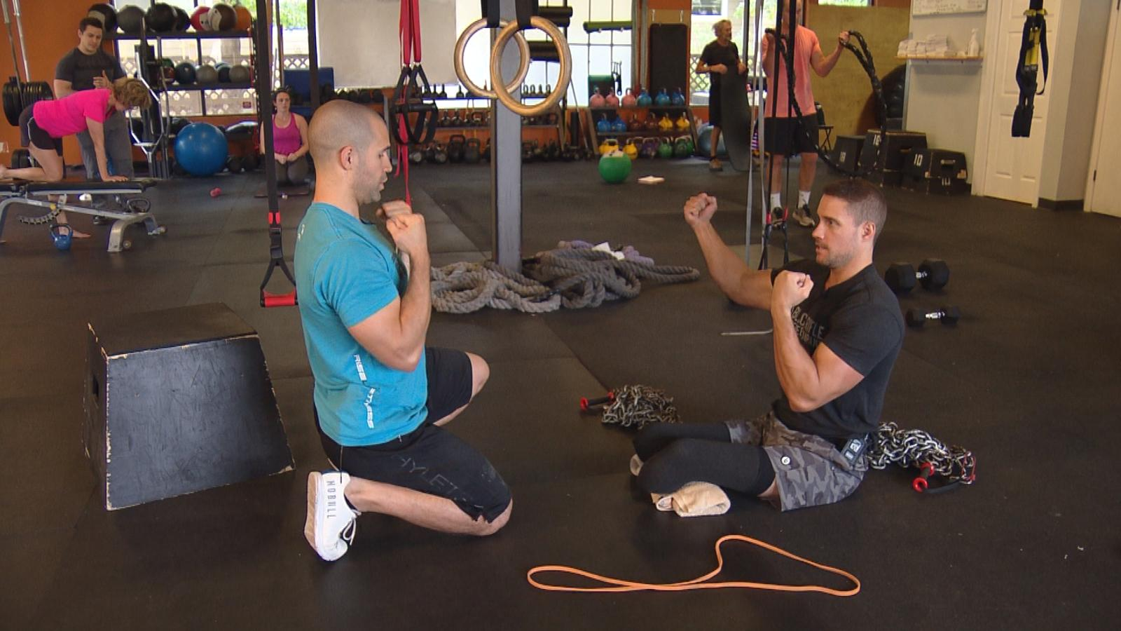 Craig Towler working out (credit: CBS)