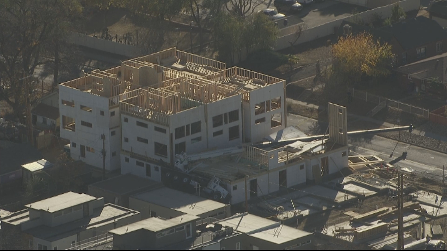 Copter4 flew over the tipped crane at 42nd and Pecos Street (credit: CBS)