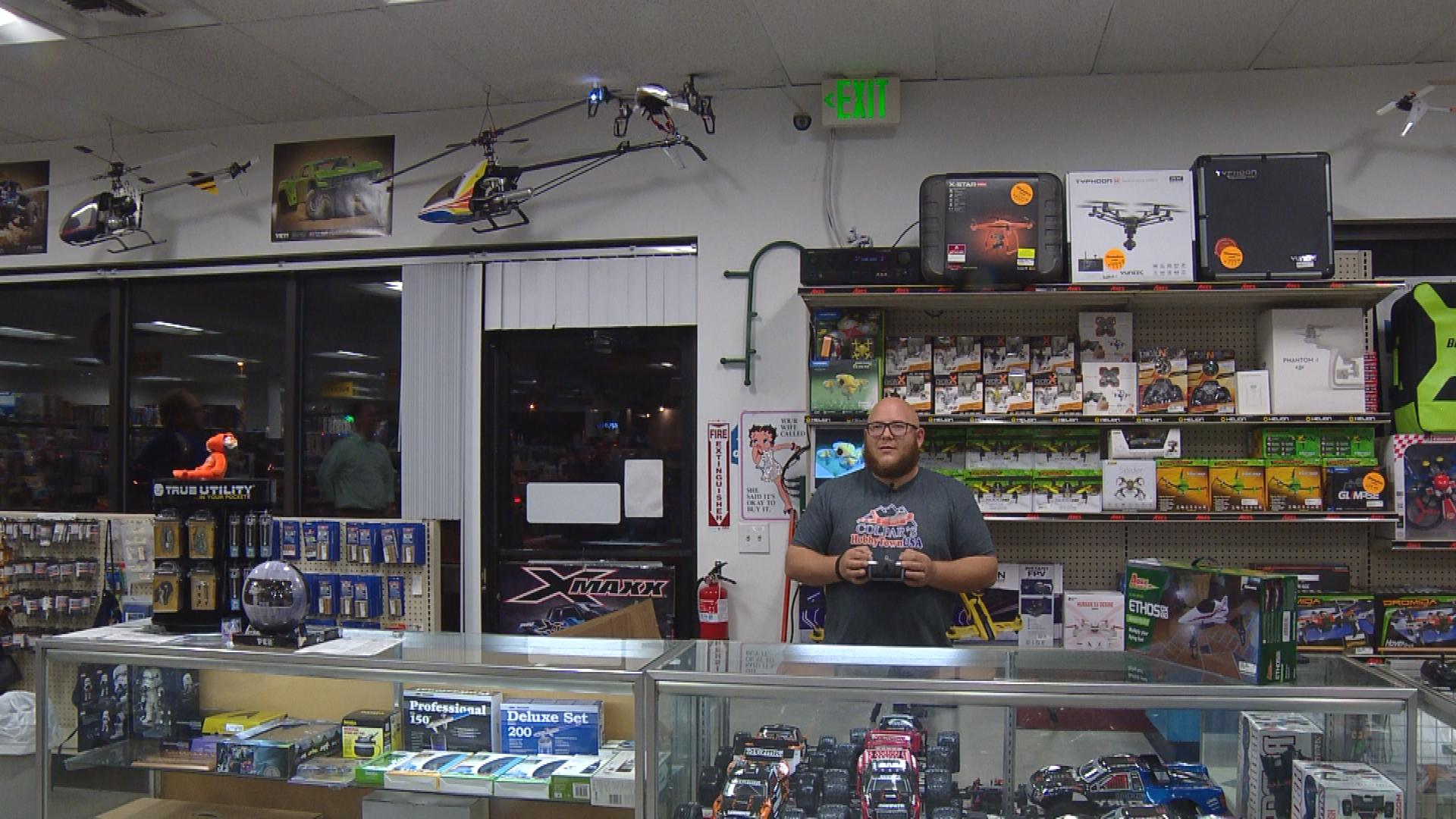 Sid Vega, a drone expert at Colpars Hobbytown in Lakewood fly a drone (credit: CBS)