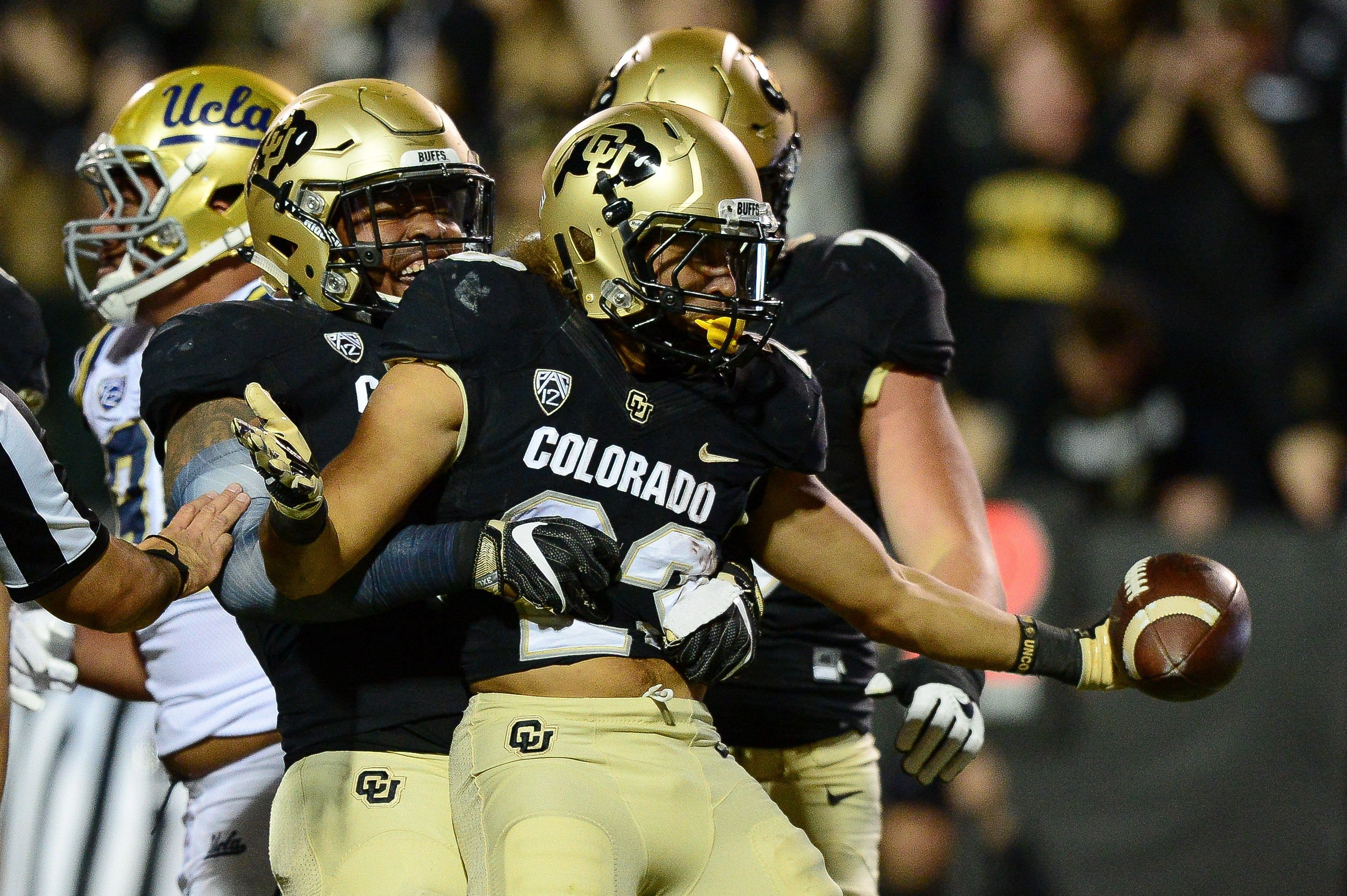 Running back Phillip Lindsay #23 of the Colorado Buffaloes celebrates a touchdown with tight end George Frazier #5 in the first quarter of a game against the UCLA Bruins at Folsom Field on November 3, 2016 in Boulder, Colorado. (Photo by Dustin Bradford/Getty Images)