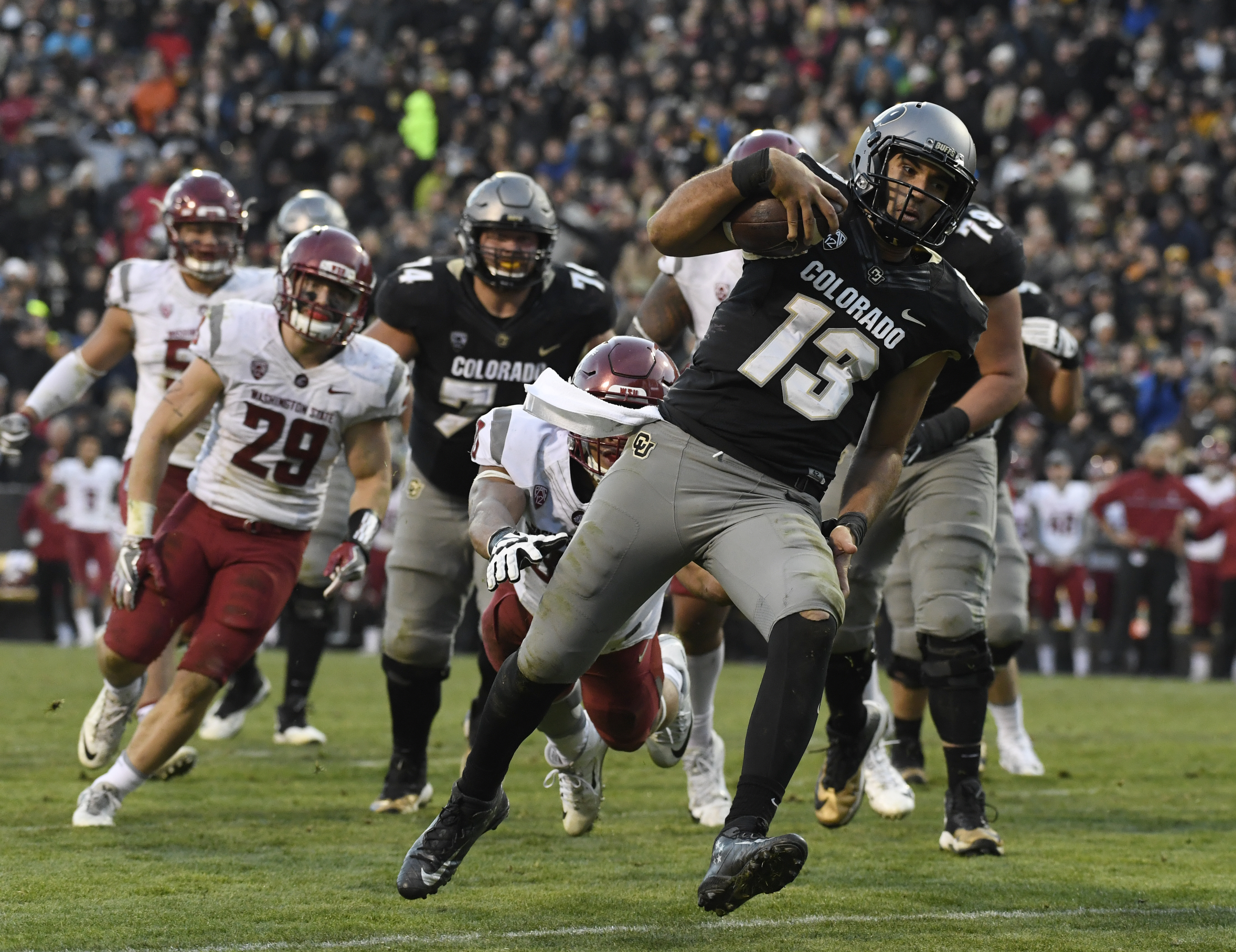 BOULDER, CO - November 19: Colorado Buffaloes quarterback Sefo Liufau #13 eludes Washington State Cougars defensive lineman Nnamdi Oguayo #30 for a touchdown in the third quarter at Folsom Field November 19, 2016. (Photo by Andy Cross/The Denver Post via Getty Images)