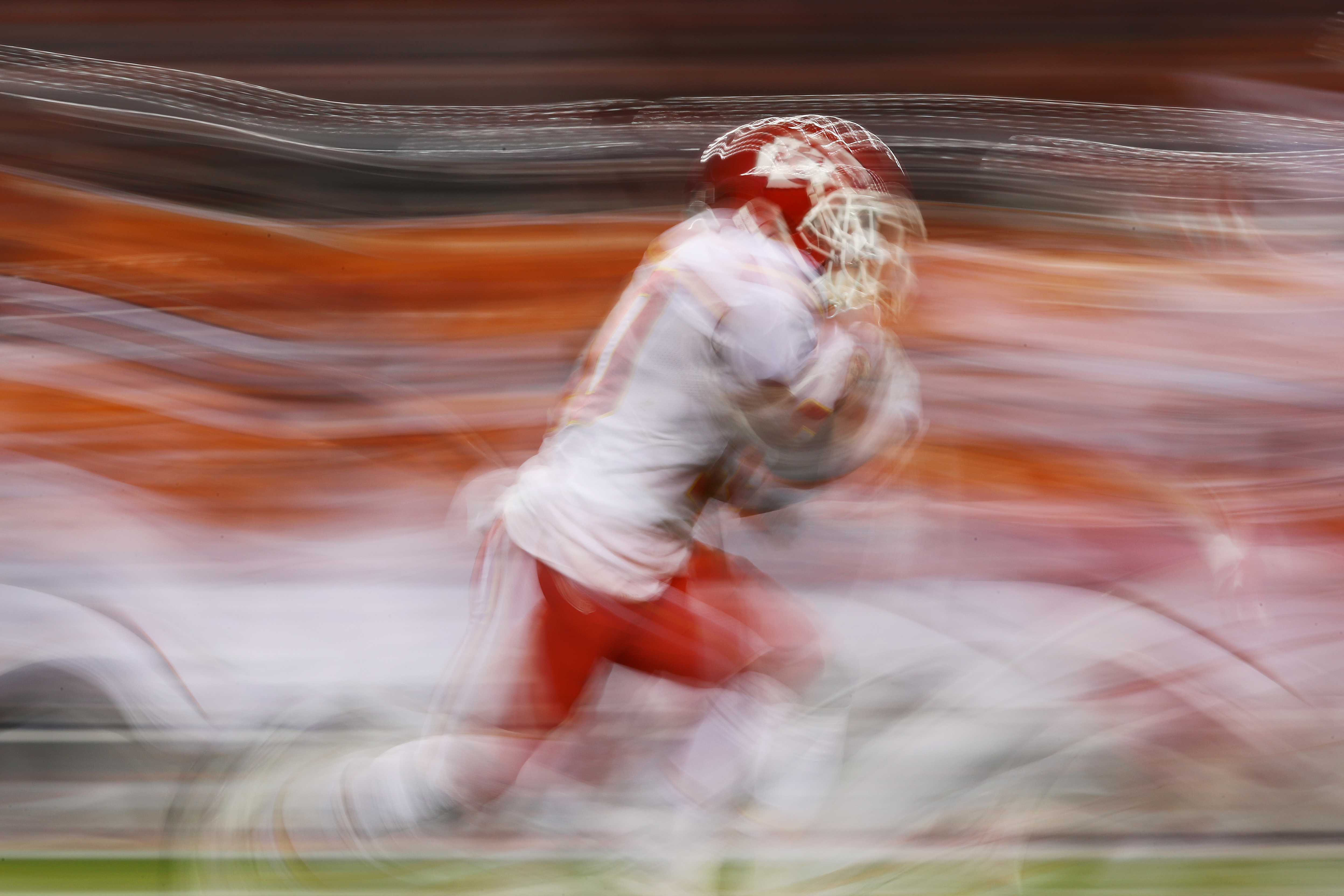 Wide receiver Tyreek Hill #10 of the Kansas City Chiefs returns a punt in the first quarter of the game against the Denver Broncos at Sports Authority Field at Mile High on November 27, 2016 in Denver, Colorado. (Photo by Ezra Shaw/Getty Images)