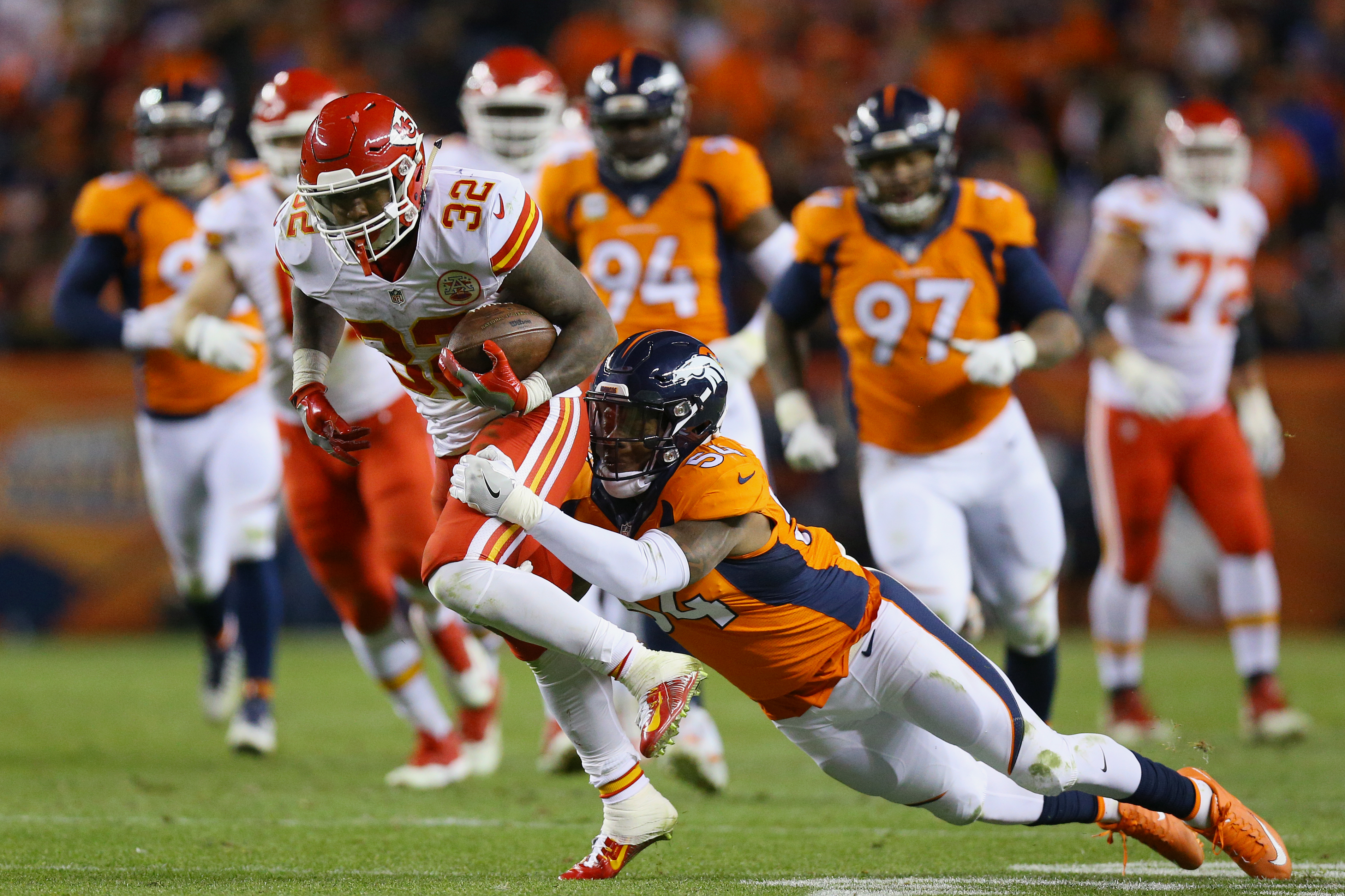 Running back Spencer Ware of the Kansas City Chiefs catches a pass and is tackled by inside linebacker Brandon Marshall of the Denver Broncos on Nov. 27, 2016 in Denver. (Photo by Justin Edmonds/Getty Images)