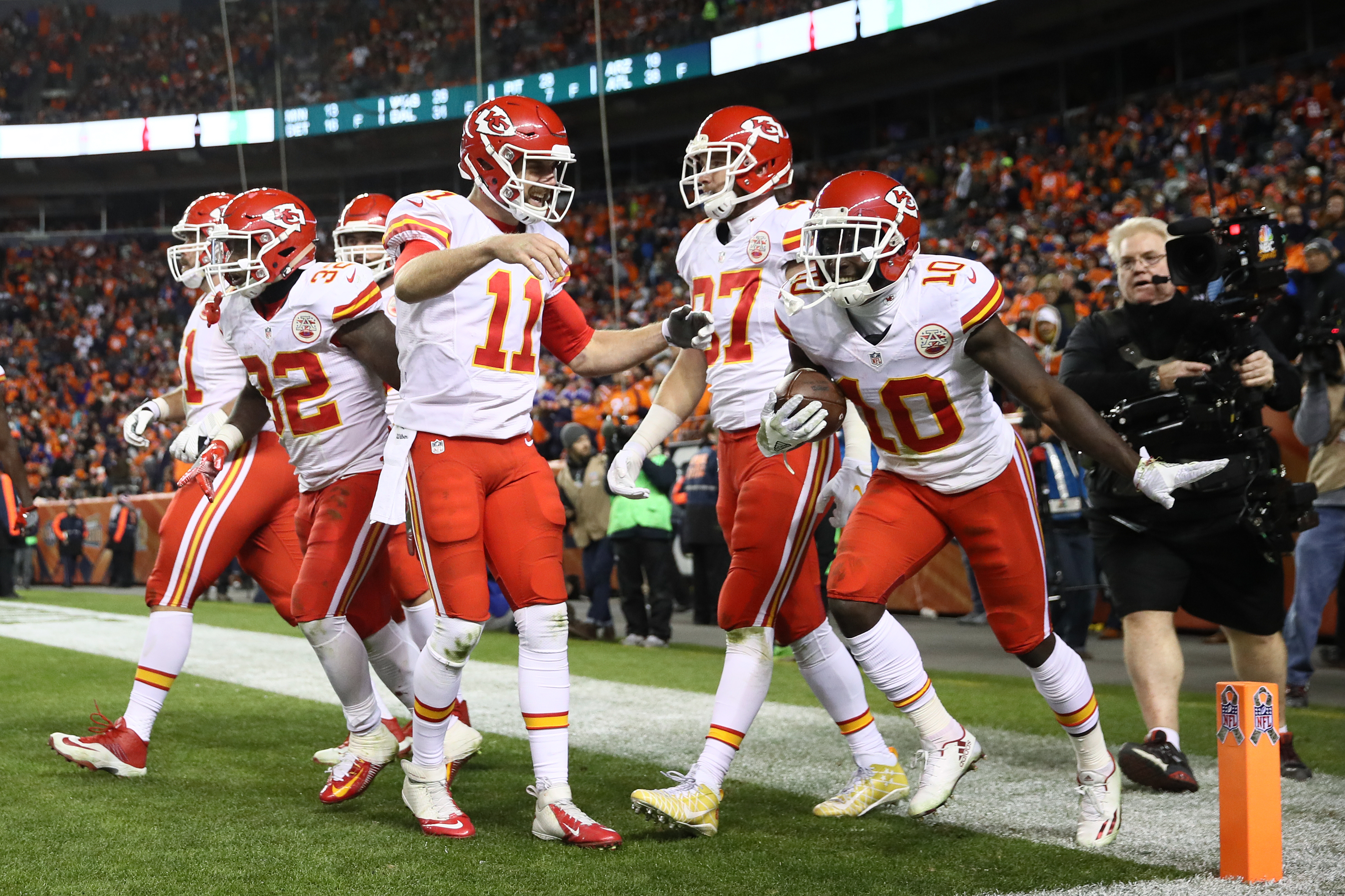Quarterback Alex Smith #11 of the Kansas City Chiefs celebrates with Tyreek Hill #10 after he scored a touchdown in the third quarter of the game against the Denver Broncos at Sports Authority Field at Mile High on November 27, 2016 in Denver, Colorado. (Photo by Ezra Shaw/Getty Images)