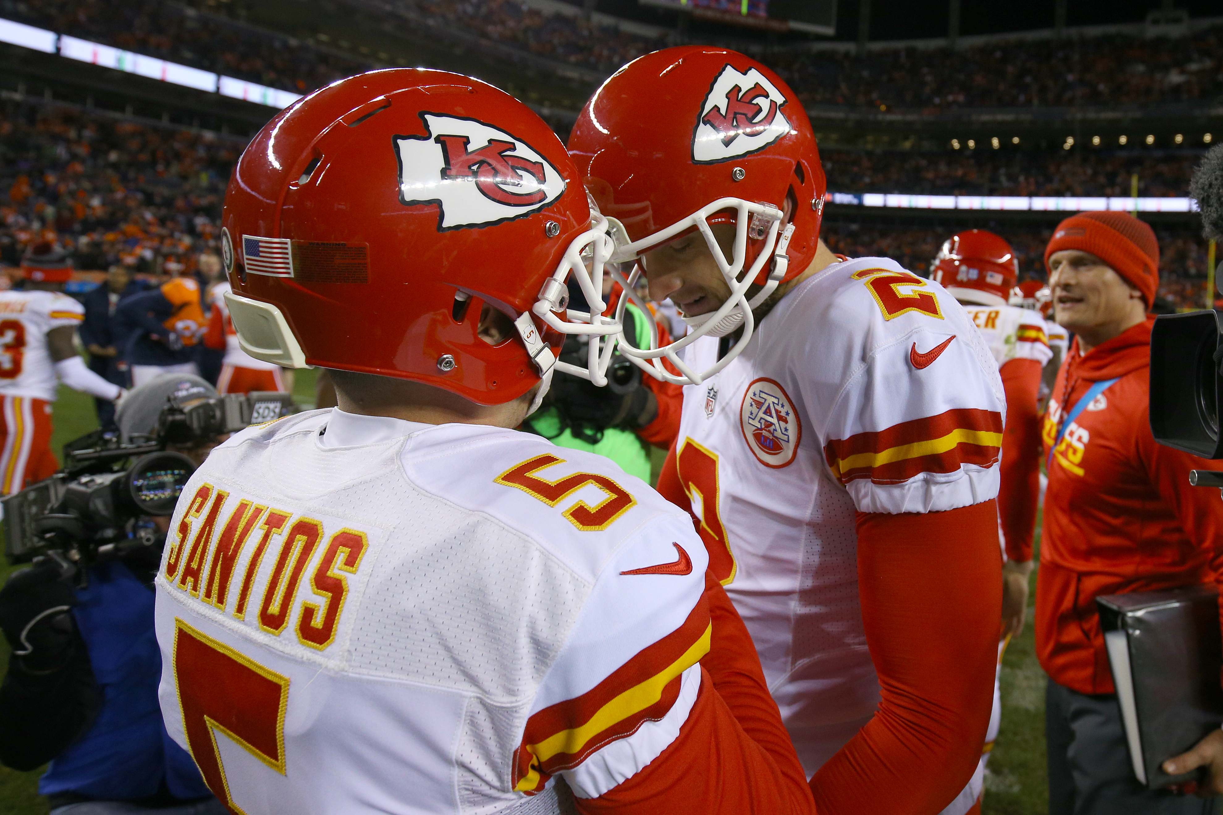 DENVER, CO - NOVEMBER 27: Dustin Colquitt #2 of the Kansas City Chiefs celebrates with kicker Cairo Santos #5 after he made a game-winning field goal in overtime against the Denver Broncos at Sports Authority Field at Mile High on November 27, 2016 in Denver, Colorado. (Photo by Justin Edmonds/Getty Images)