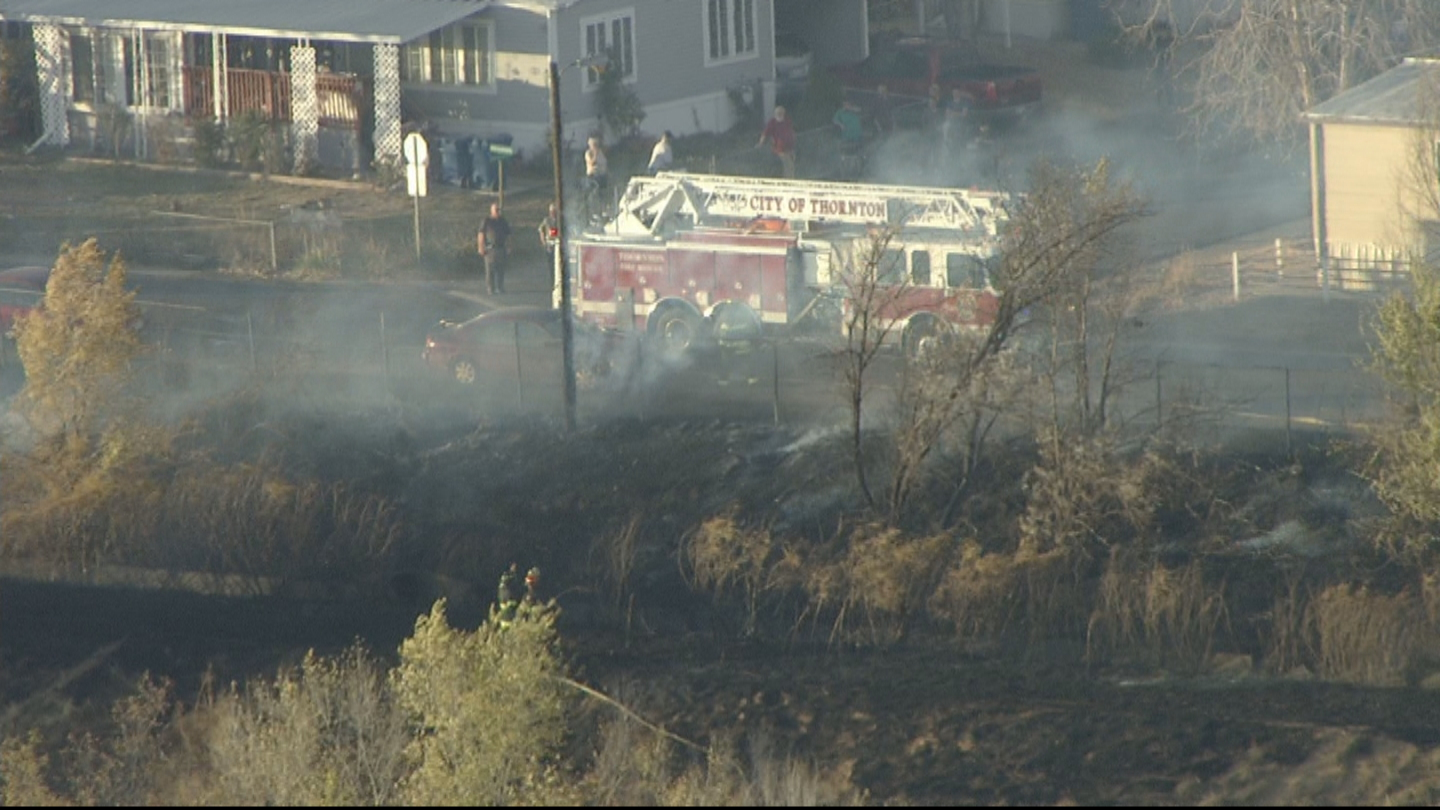 Copter4 flew over a brush fire in Thornton (credit: CBS)