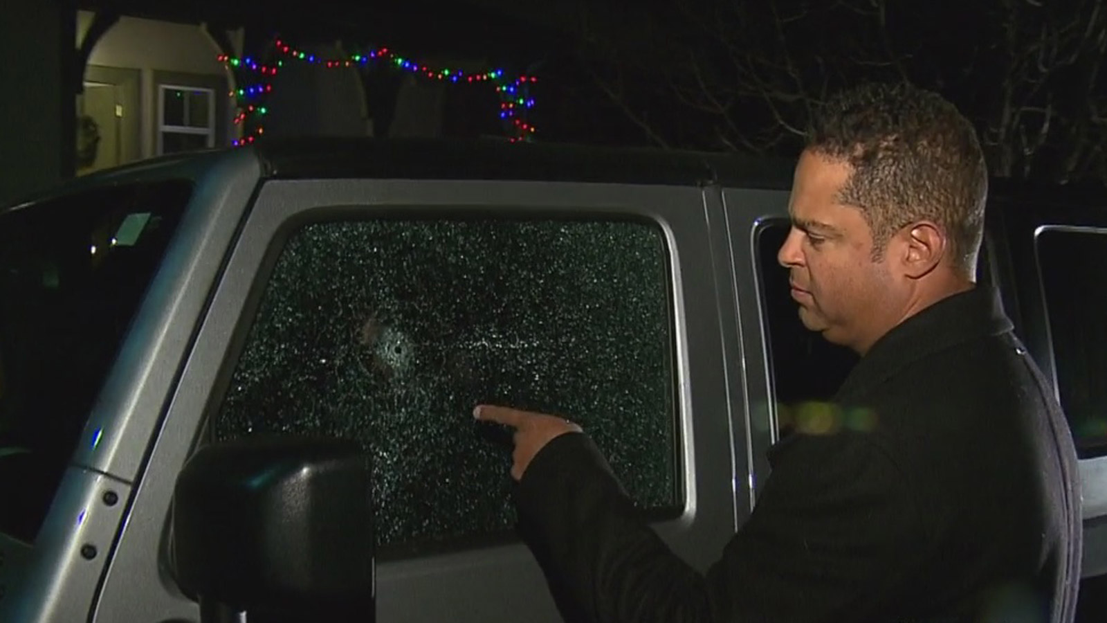 Samuel Thompson shows CBS4 the damage to his car. (credit: CBS)