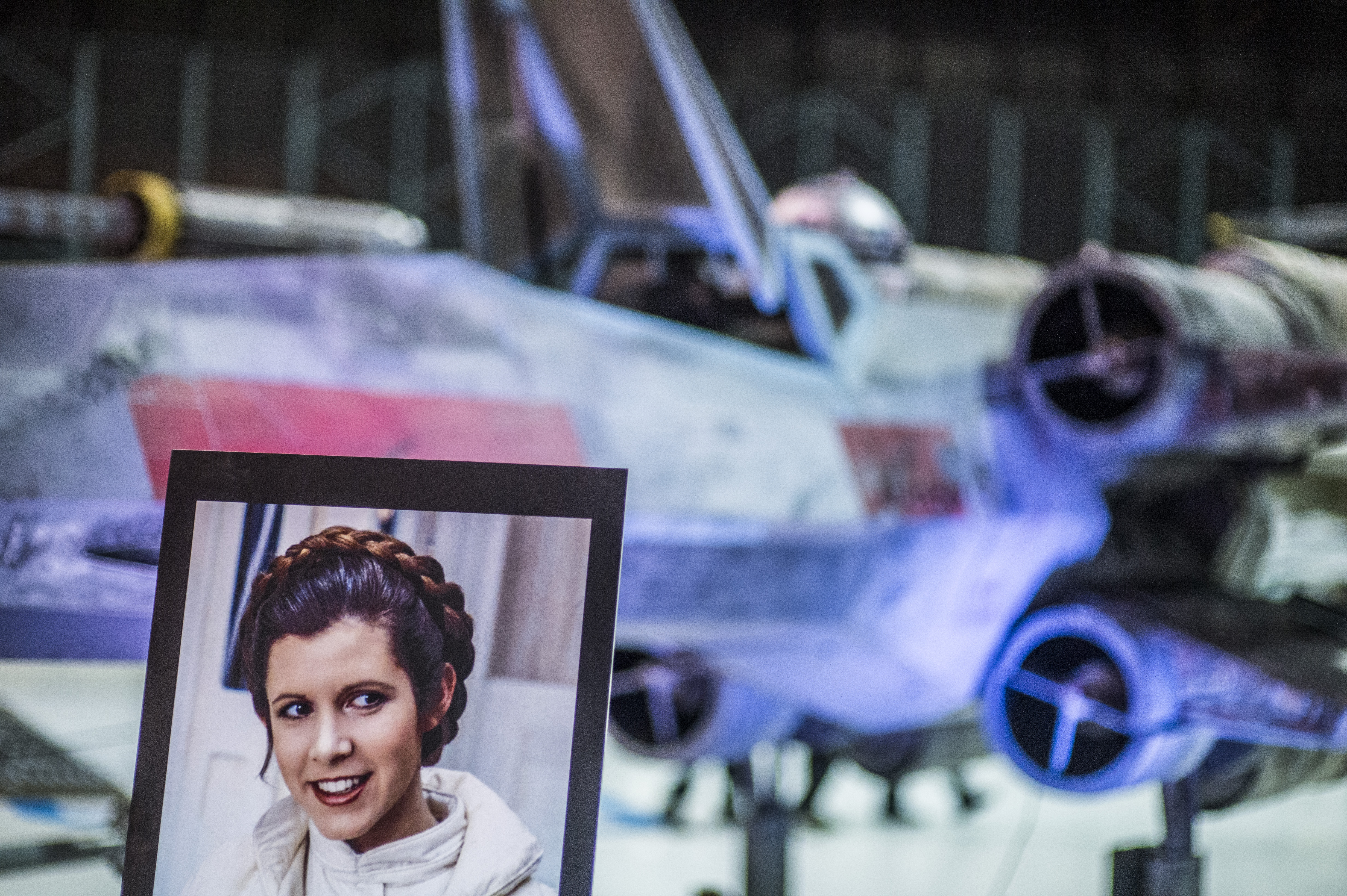 Hundreds of Carrie Fisher fans remember the iconic actress at a vigil hosted by the Wings Over the Rockies Air and Space Museum in Denver Wednesday evening December 28, 2016. photos by Evan Semón for CBS4