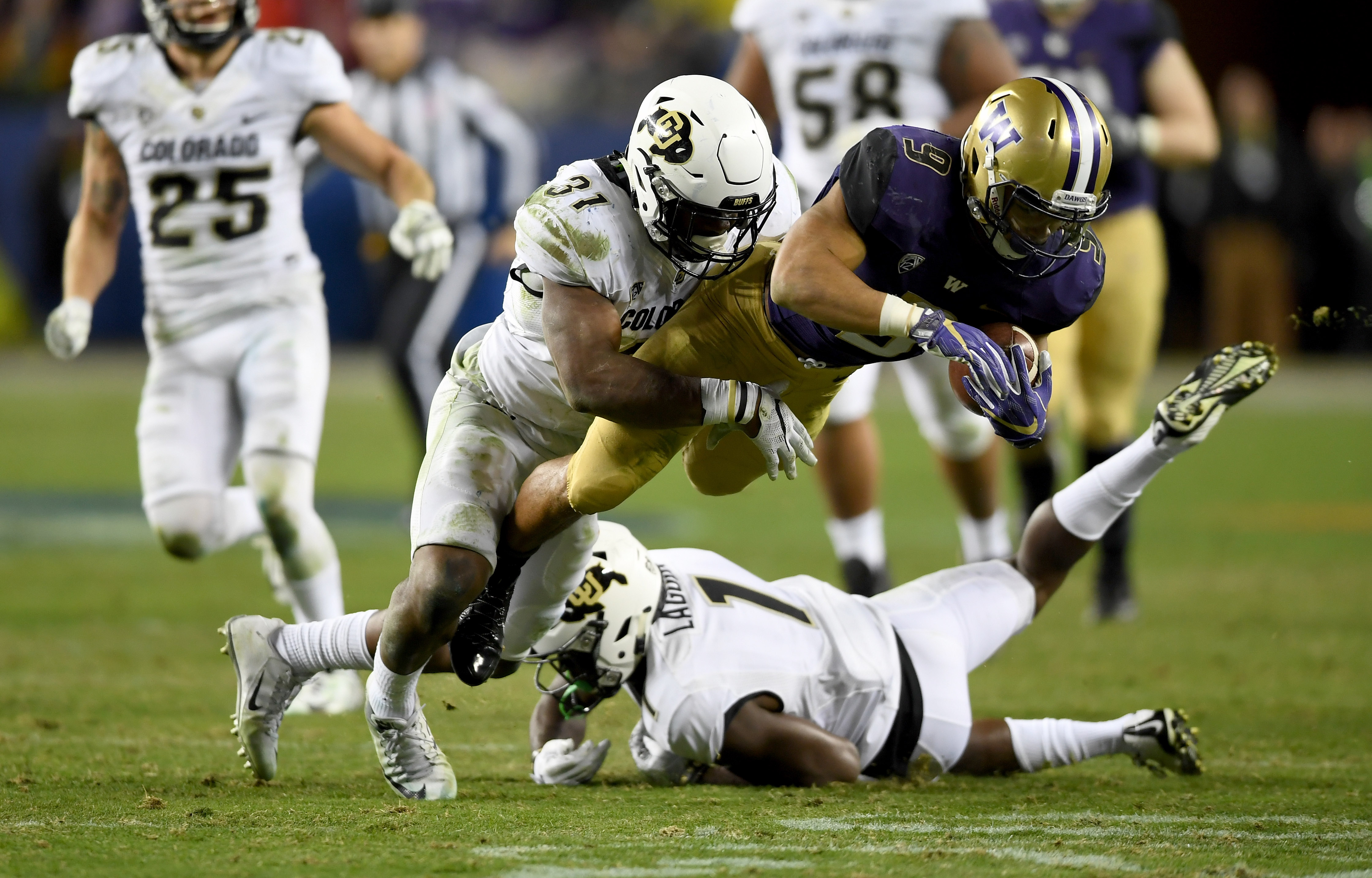 SANTA CLARA, CA - DECEMBER 02: Myles Gaskin #9 of the Washington Huskies is tackled by Kenneth Olugbode #31 of the Colorado Buffaloes during the Pac-12 Championship game at Levi's Stadium on December 2, 2016 in Santa Clara, California. (Photo by Thearon W. Henderson/Getty Images)