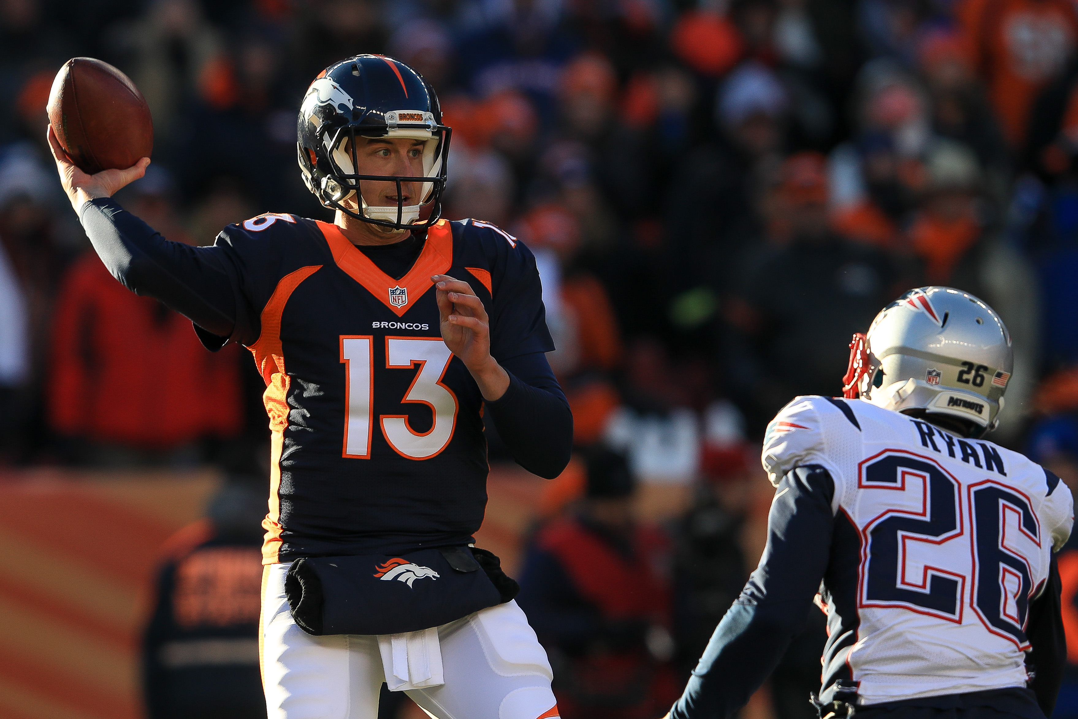 Quarterback Trevor Siemian #13 of the Denver Broncos passes against the New England Patriots in the first quarter of a game at Sports Authority Field at Mile High on December 18, 2016 in Denver, Colorado. (Photo by Sean M. Haffey/Getty Images)
